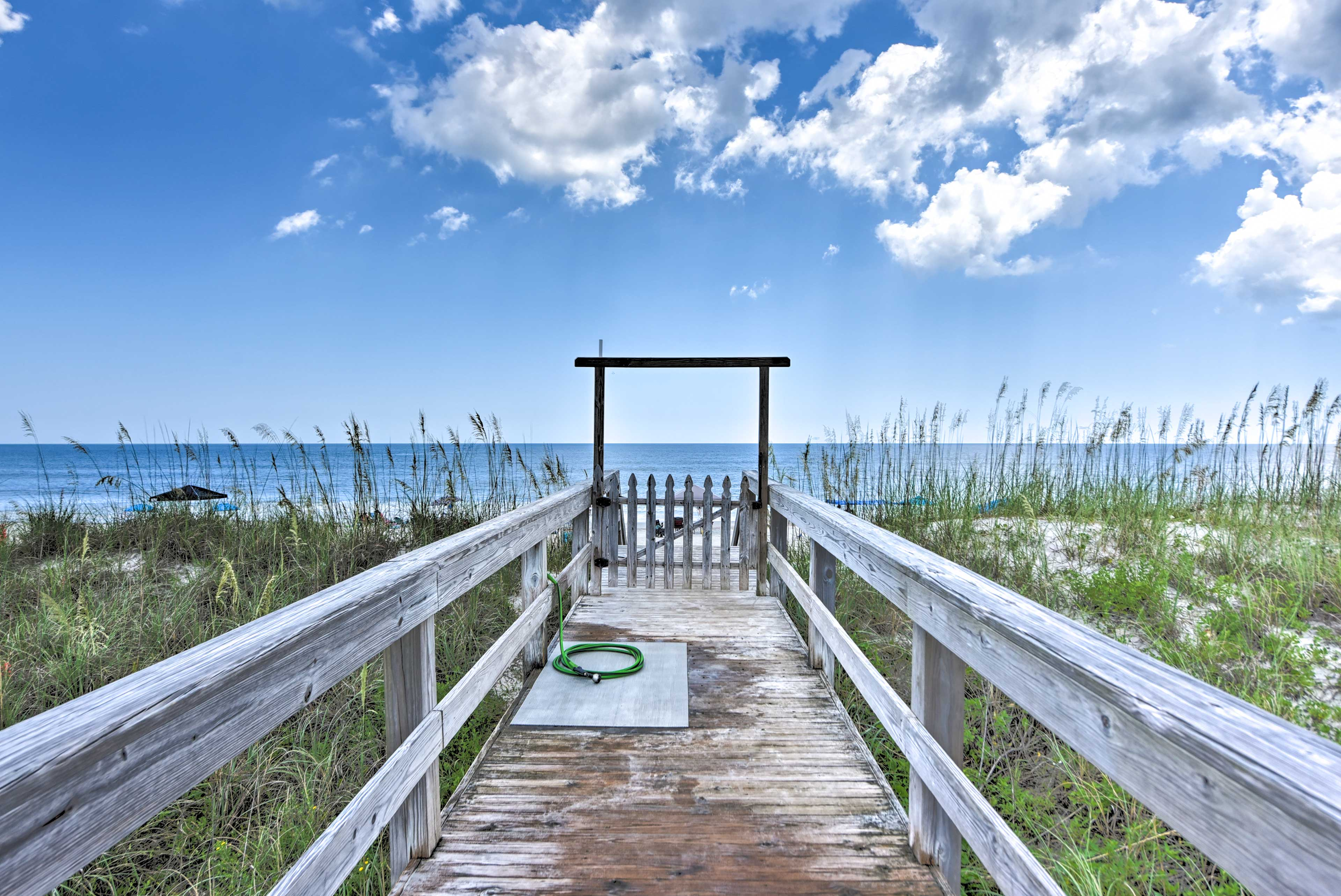 An exclusive community walkway leads you to the public beach area.