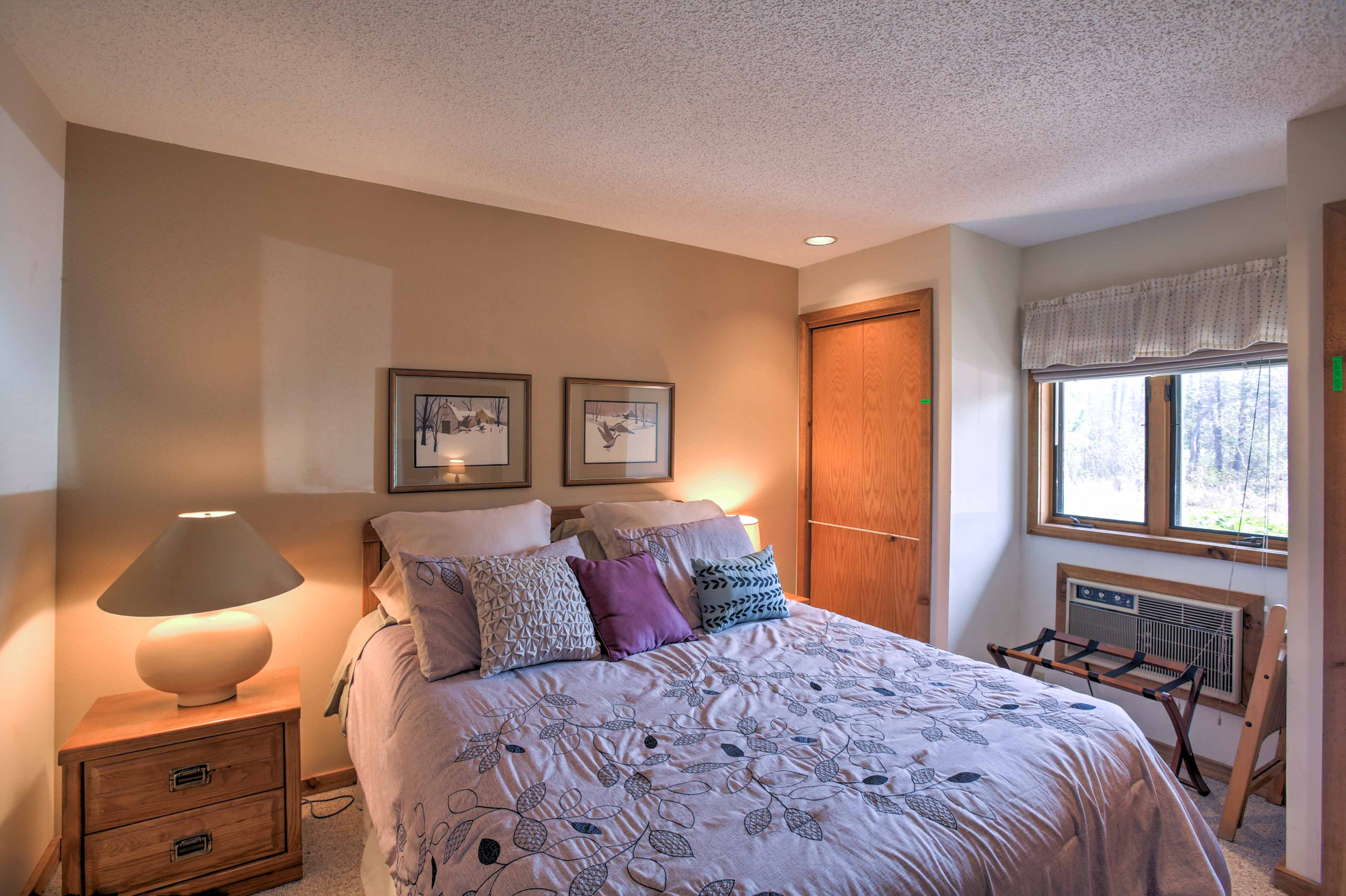 The first bedroom boasts a plush queen-sized bed.