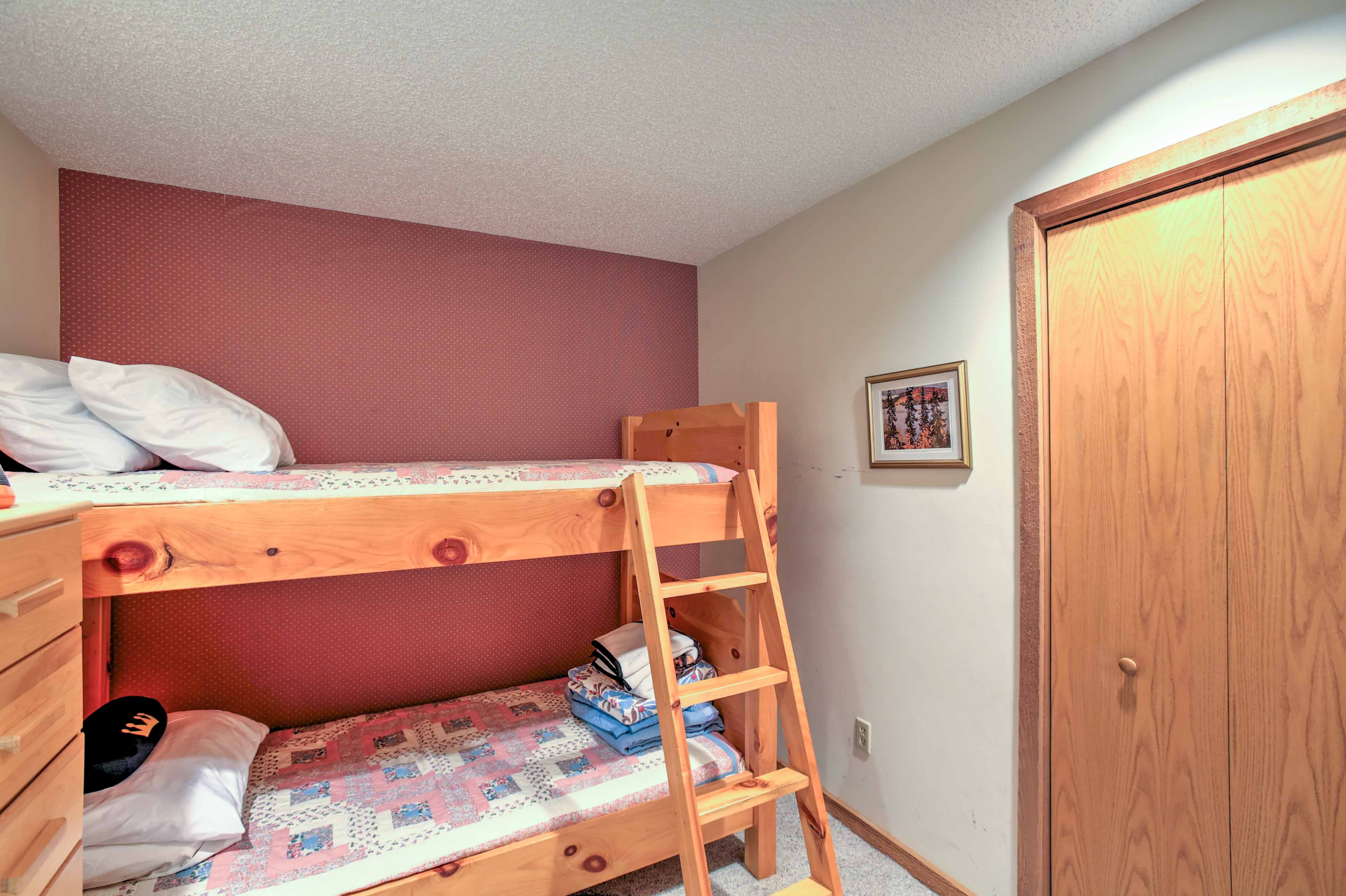 The second bedroom has twin-over-twin bunk beds and lovely wood furnishings.