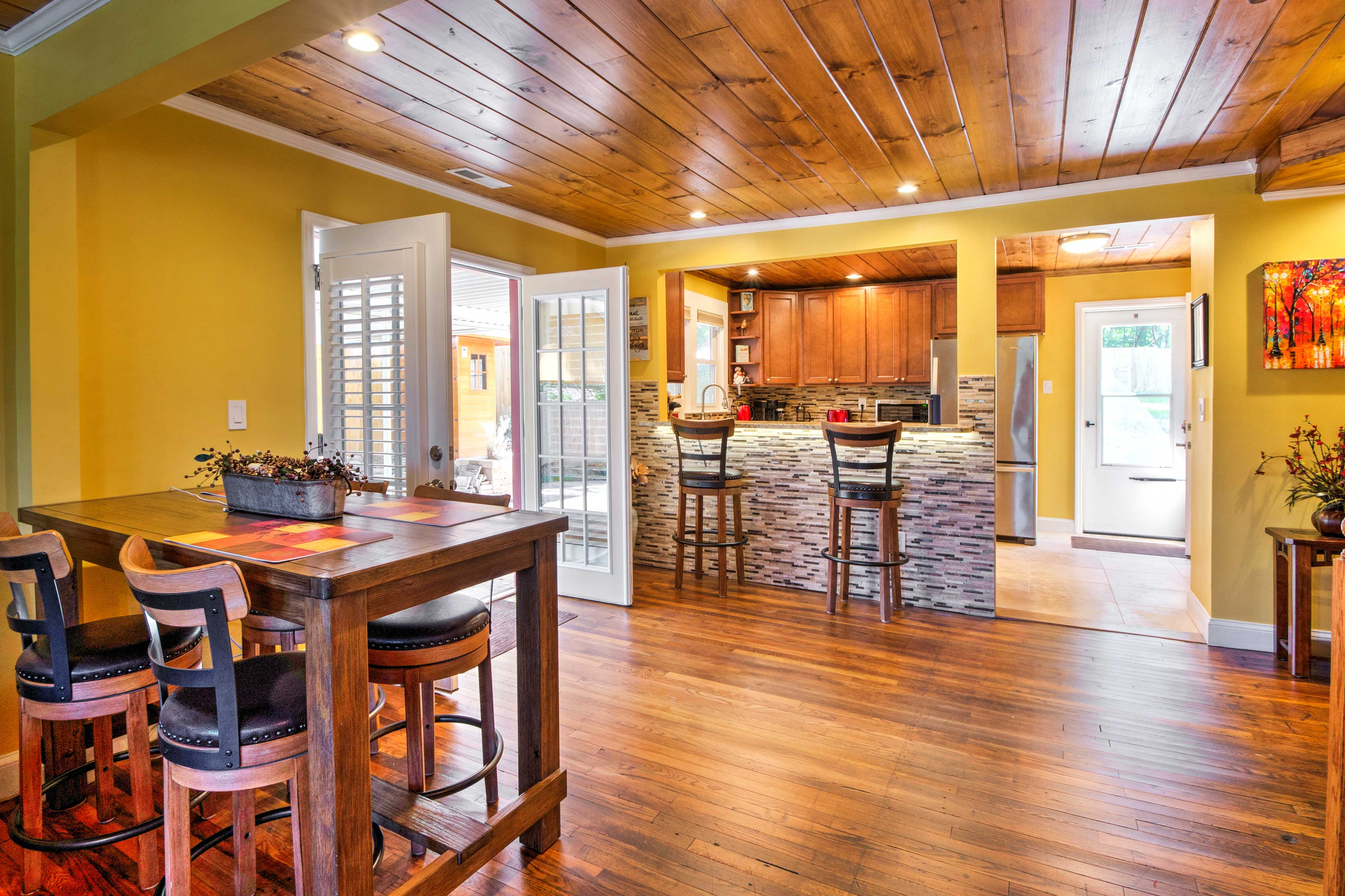 Open the large french doors that open to the covered patio for some fresh air and natural light.