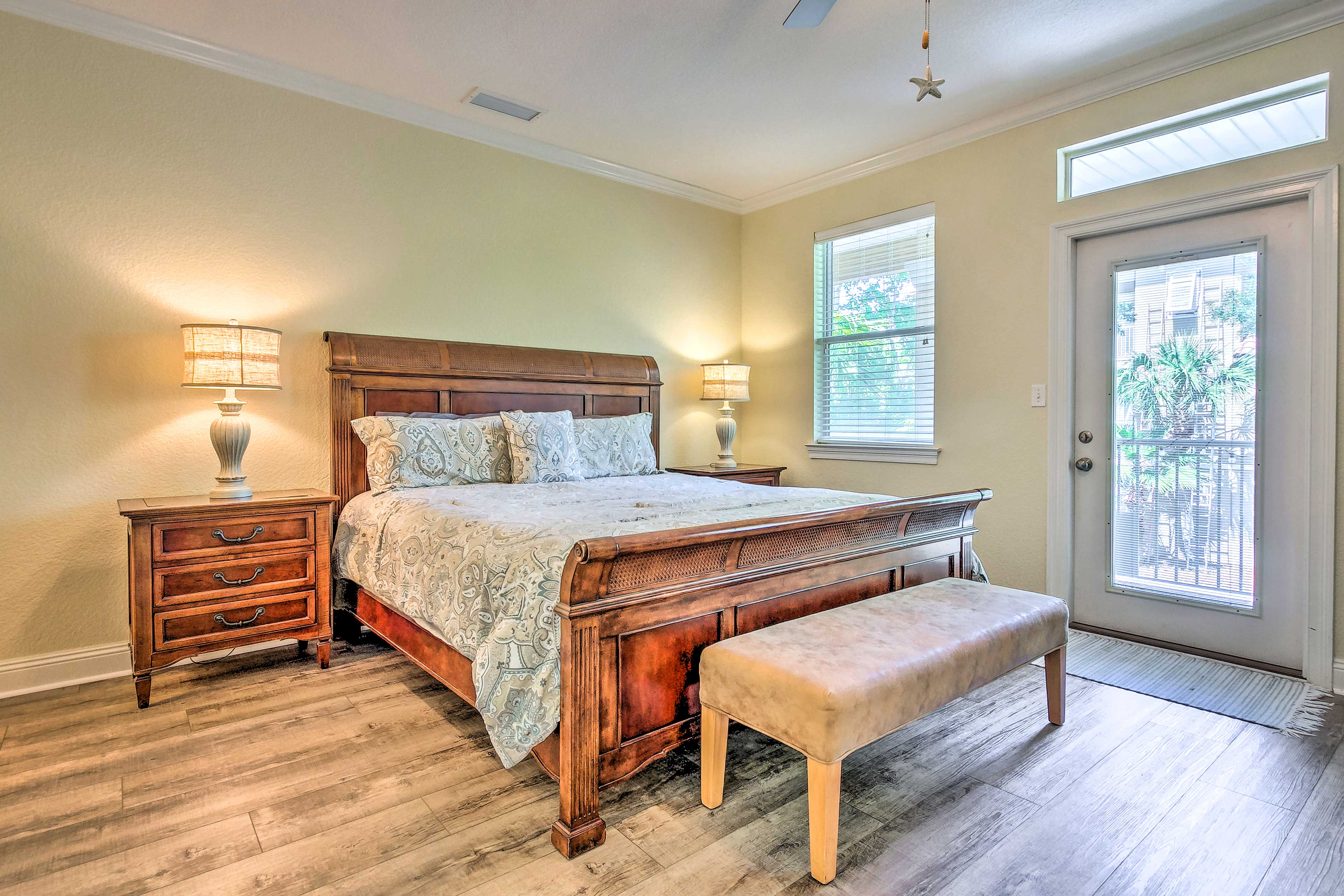 The master bedroom has a king bed and access to the private balcony.