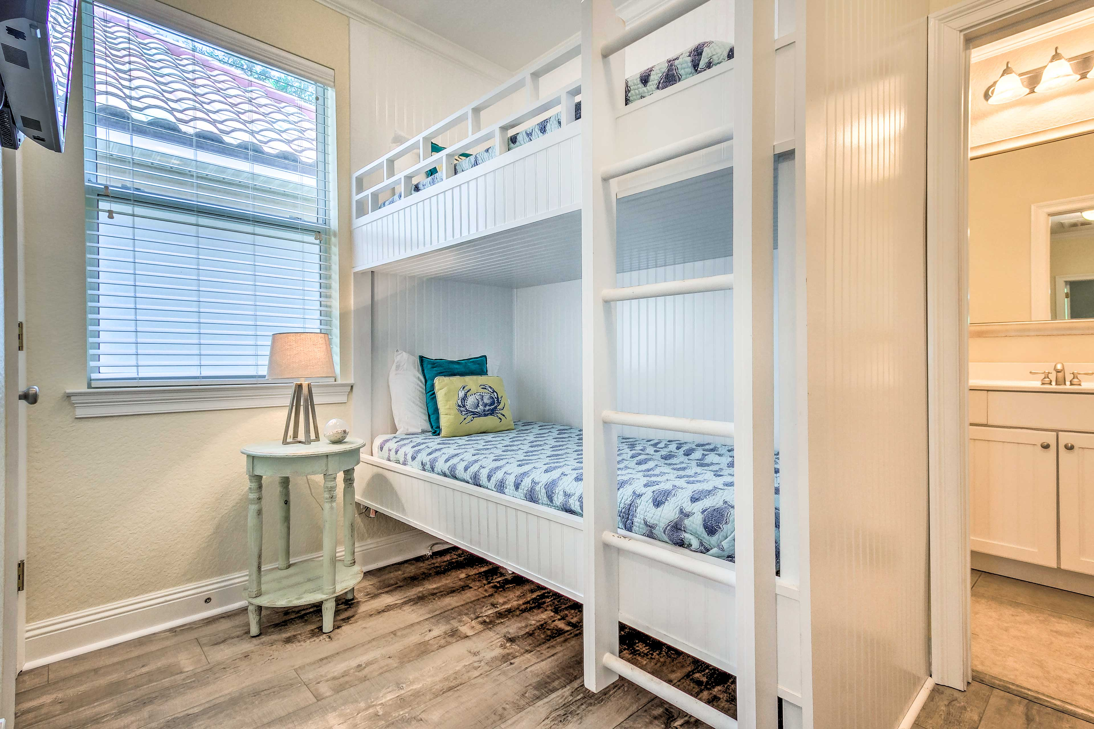 The bunk room offers a twin-over-twin bunk bed and flat-screen cable TV.