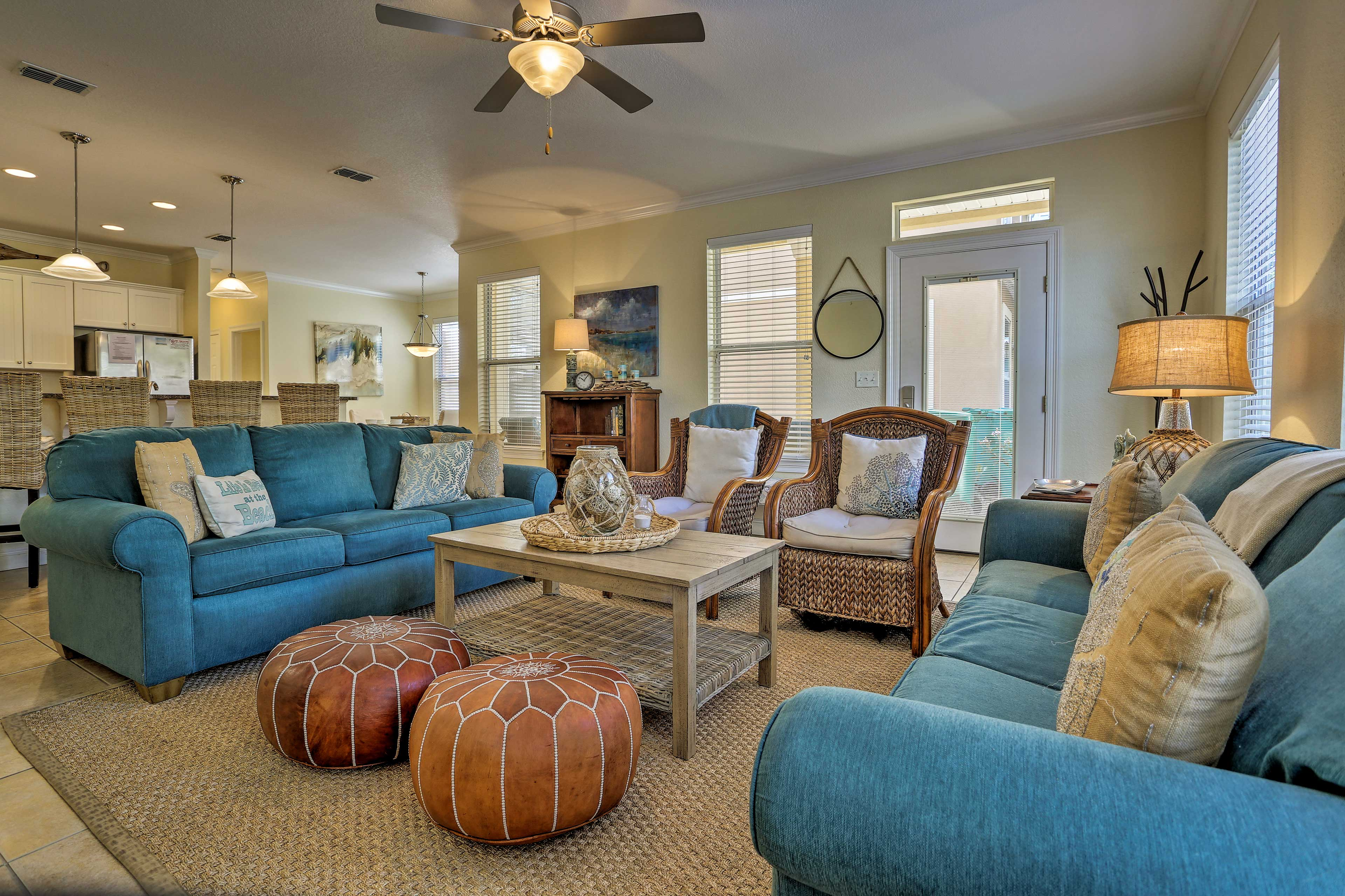 Vibrant colors and coastal decor adorn the interior of this home.