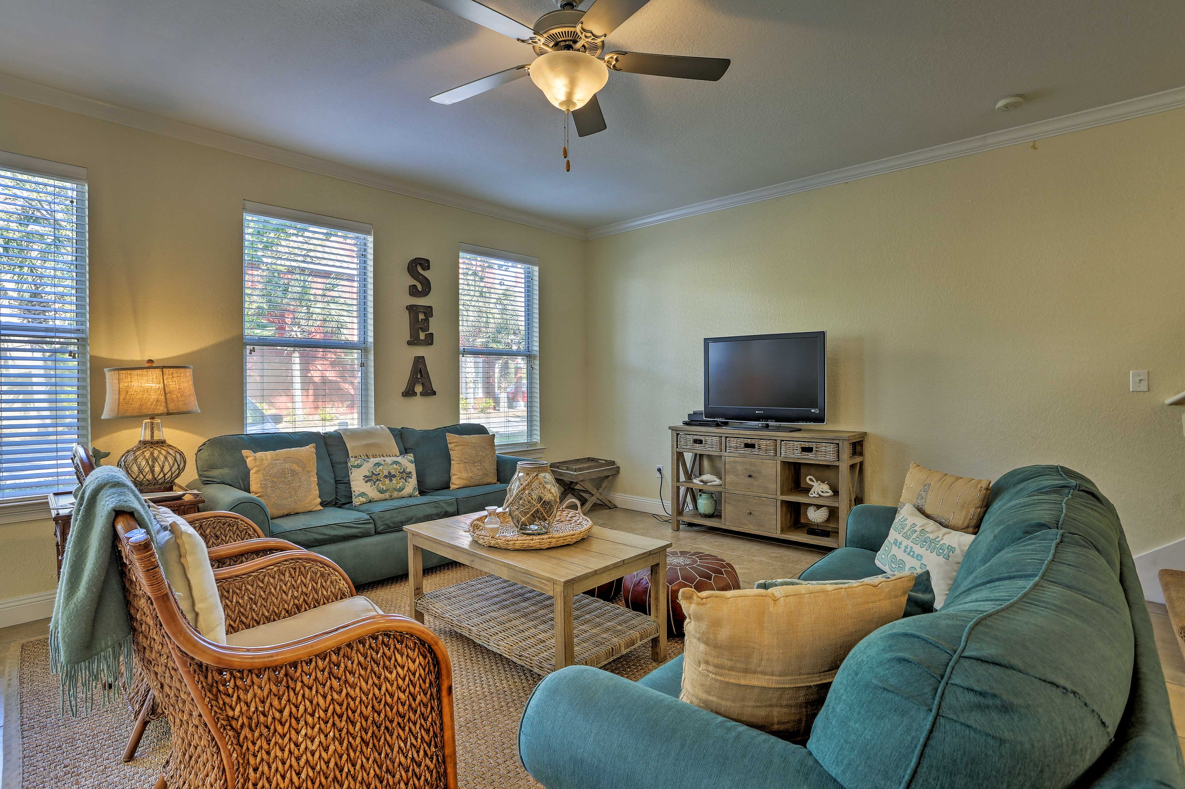 The living room offers ample seating and a flat-screen cable TV.