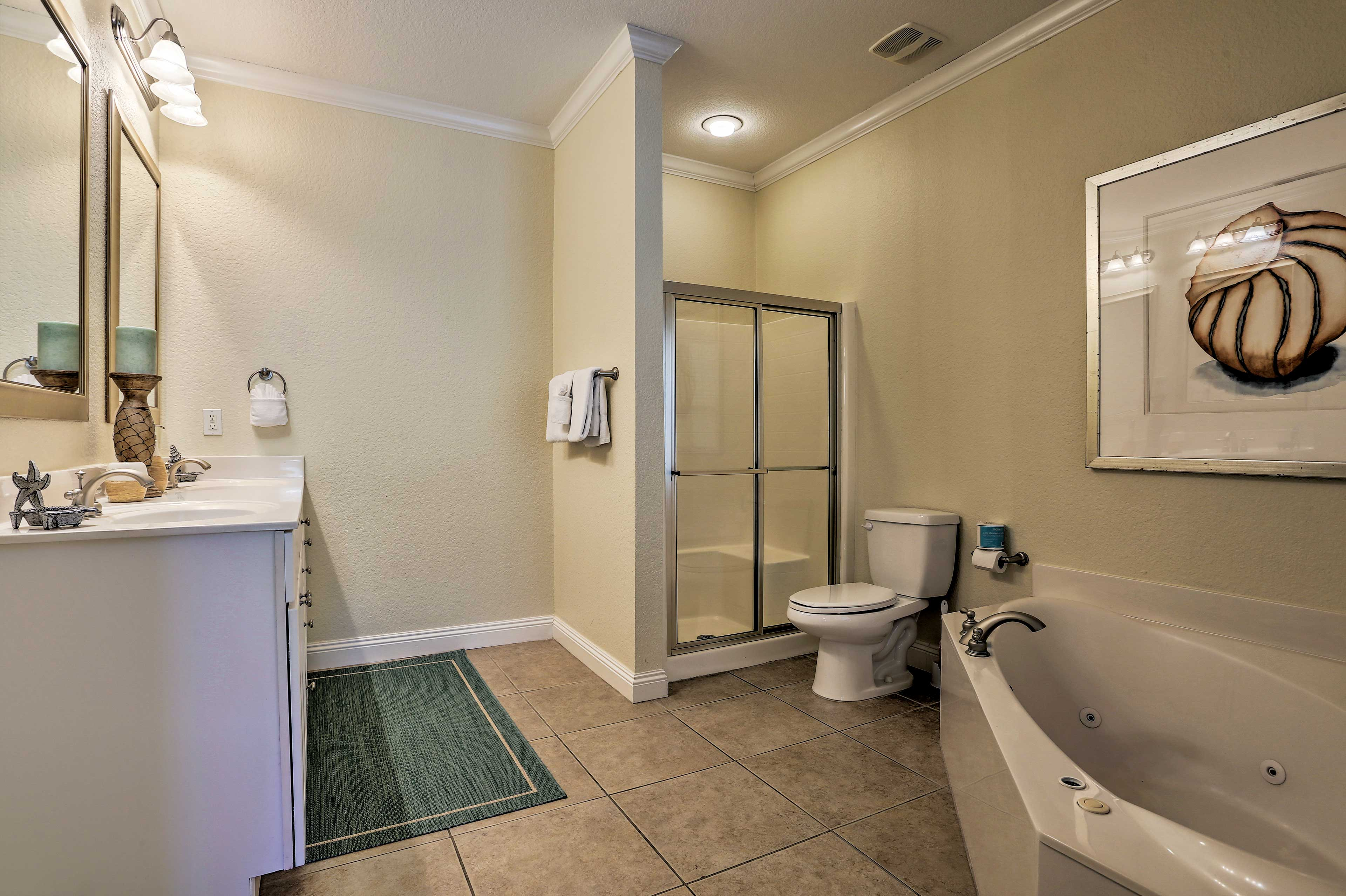 The master en-suite bathroom offers a walk-in shower and jetted tub.