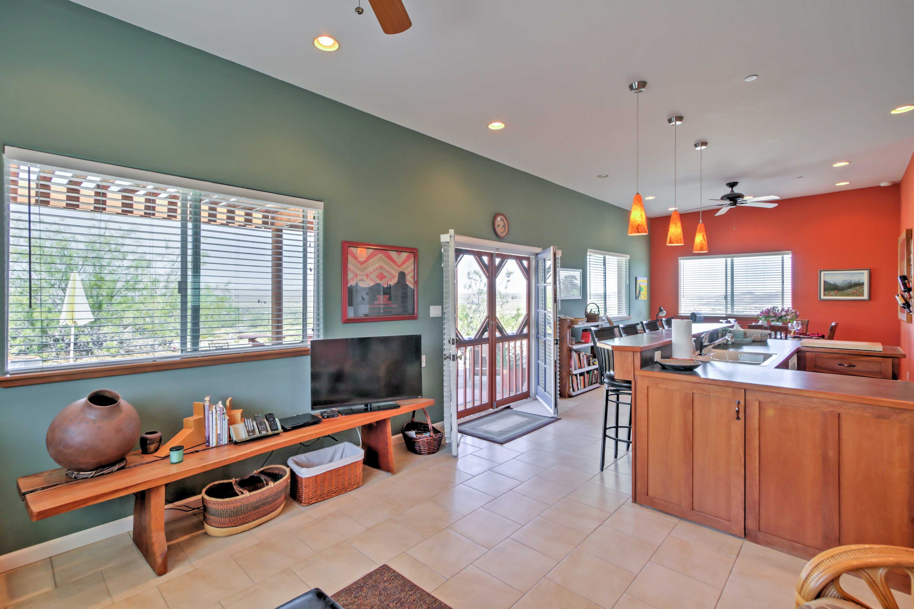 Relax in the living room and surf the channels on the flat-screen cable TV.