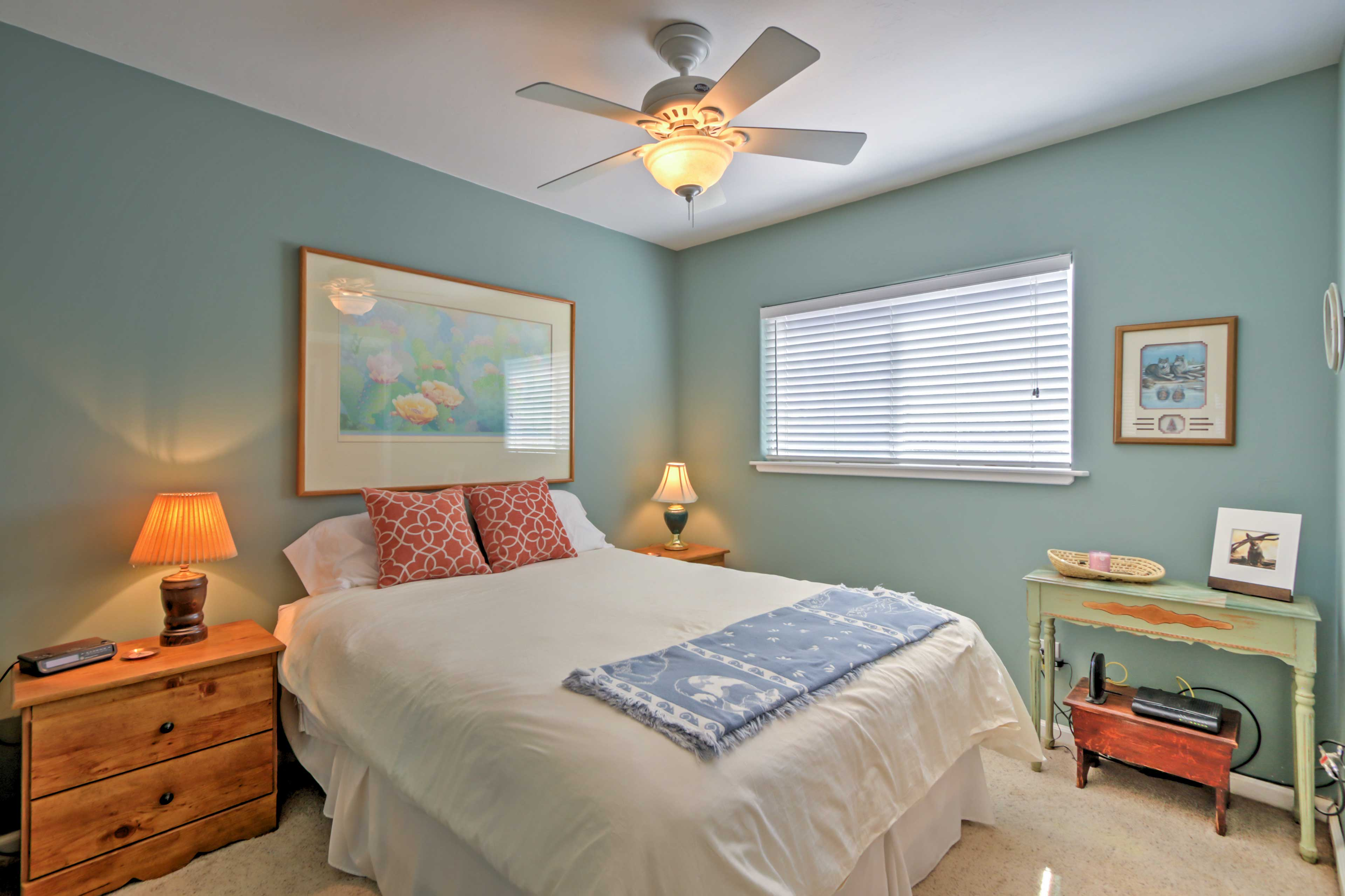 Rest easy in this cozy bedroom that features a plush queen bed.