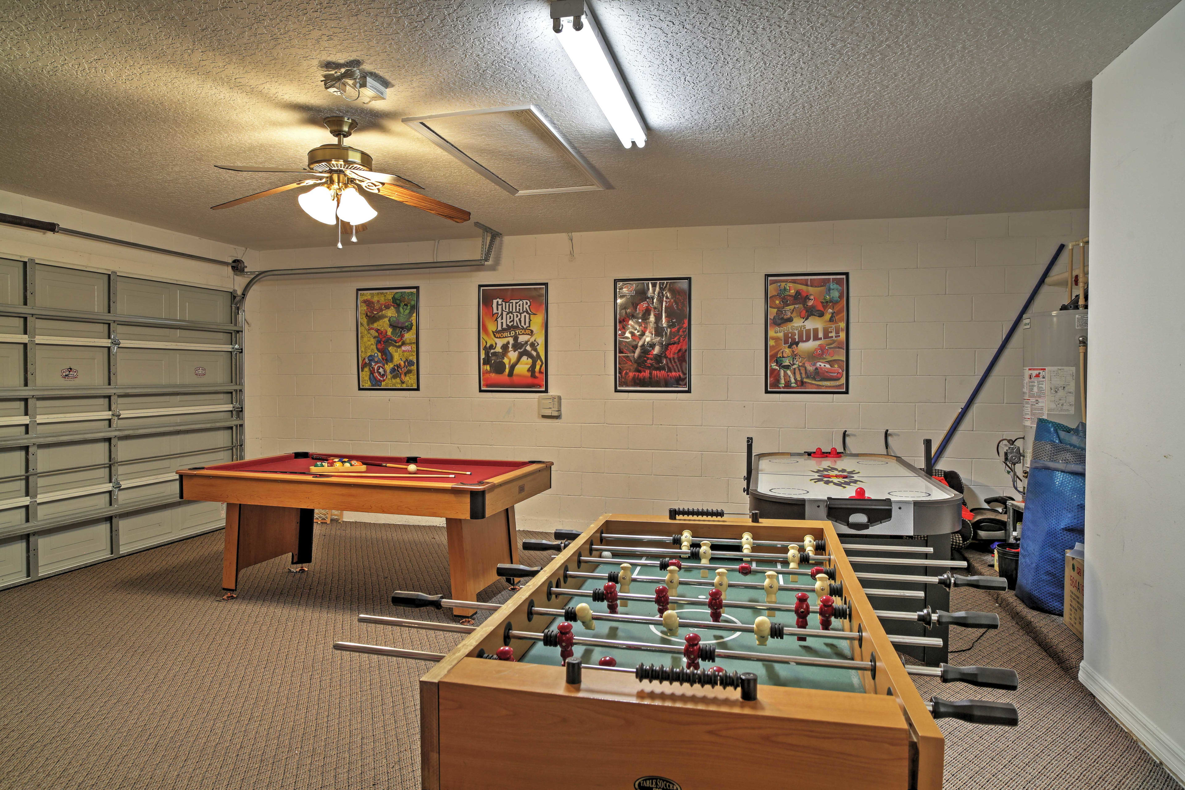 The garage has been converted into a game room with a pool table and air hockey.
