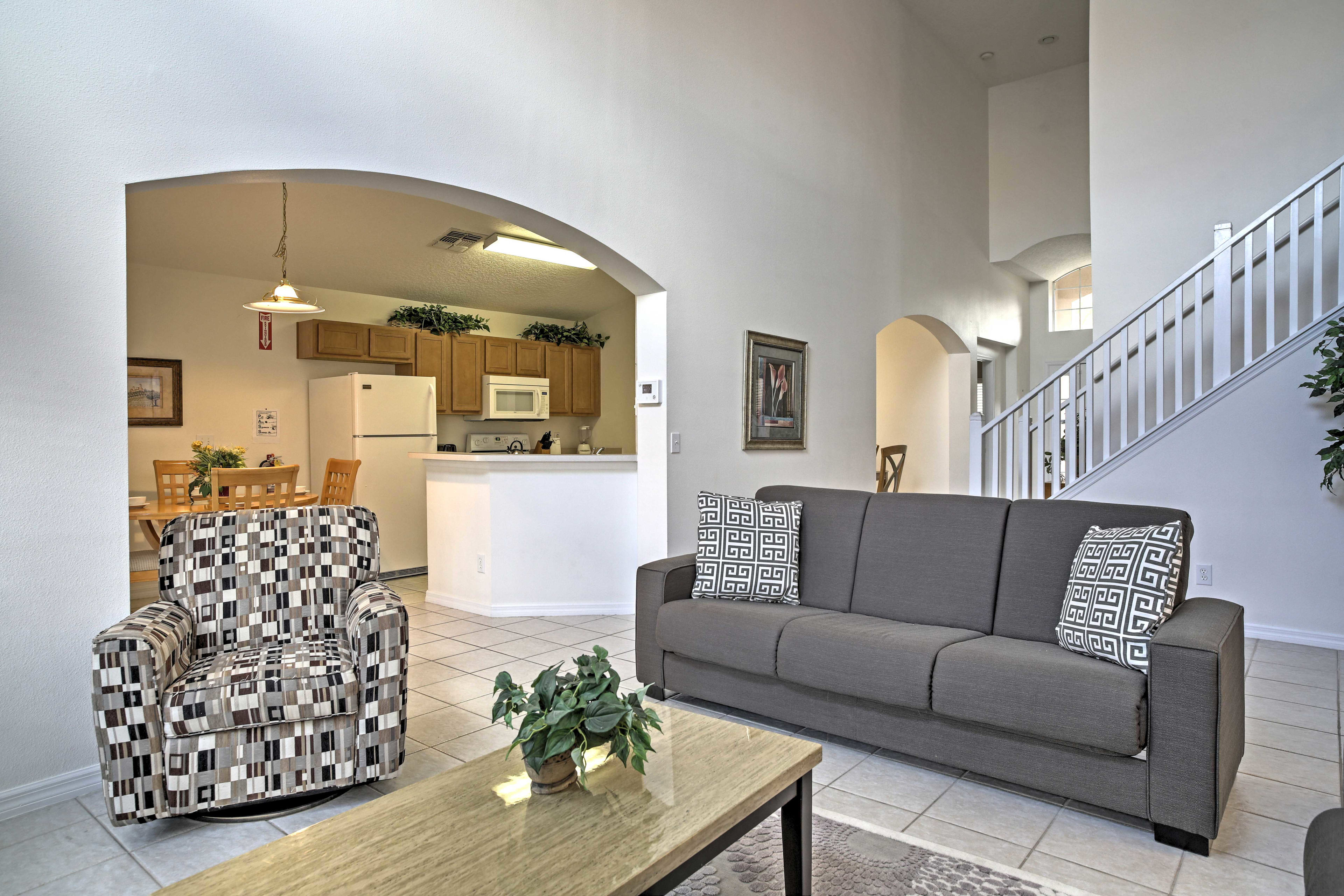 The living room flows seamlessly into the kitchen.