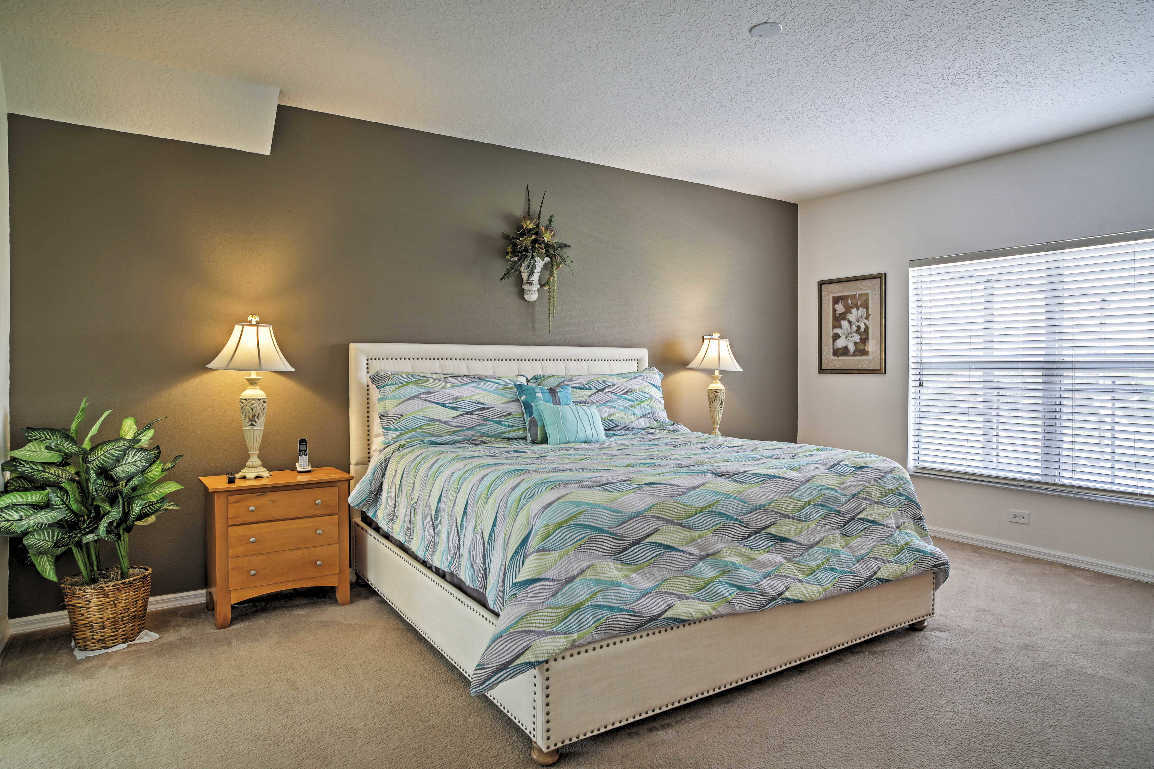 This spacious master bedroom boasts a king bed and private en-suite bathroom.