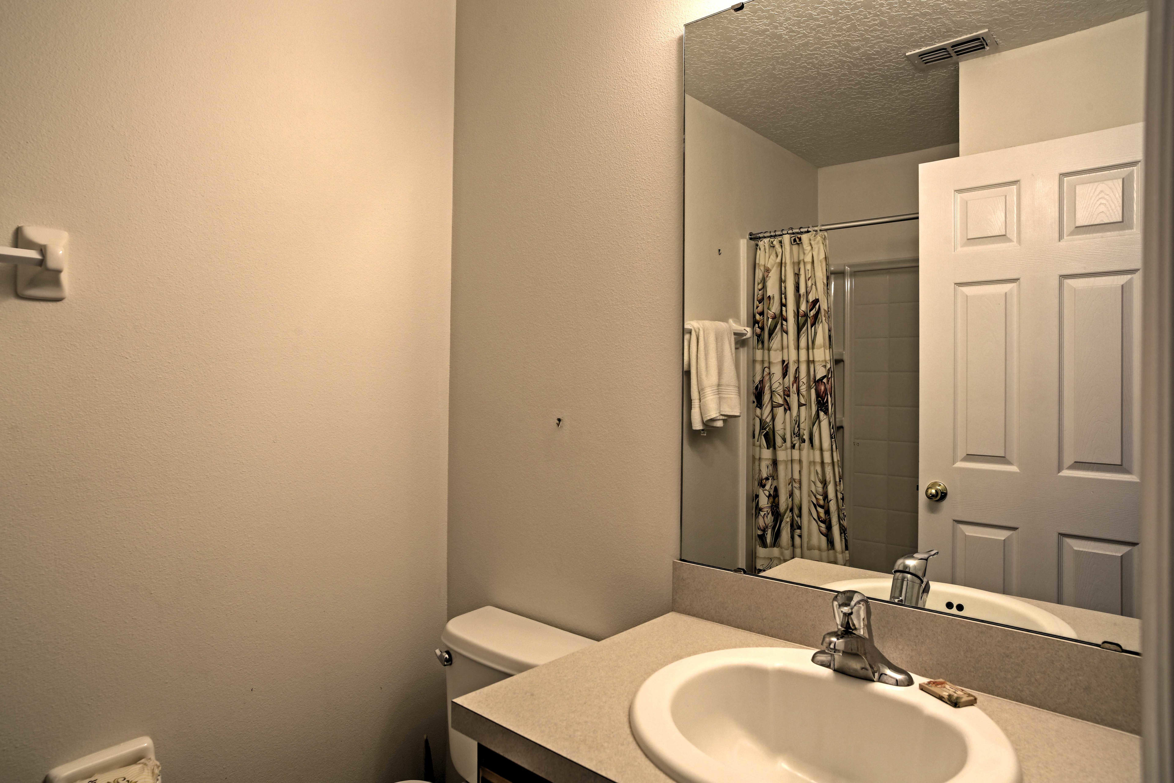 This bathroom offers a shower/tub combo.