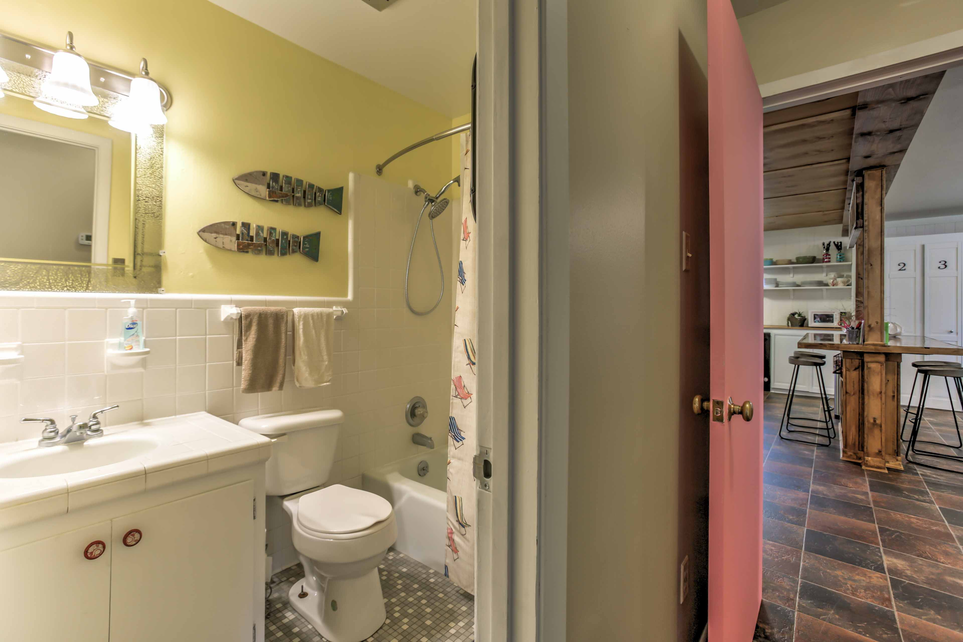 Wash up before dinner in this full bathroom.