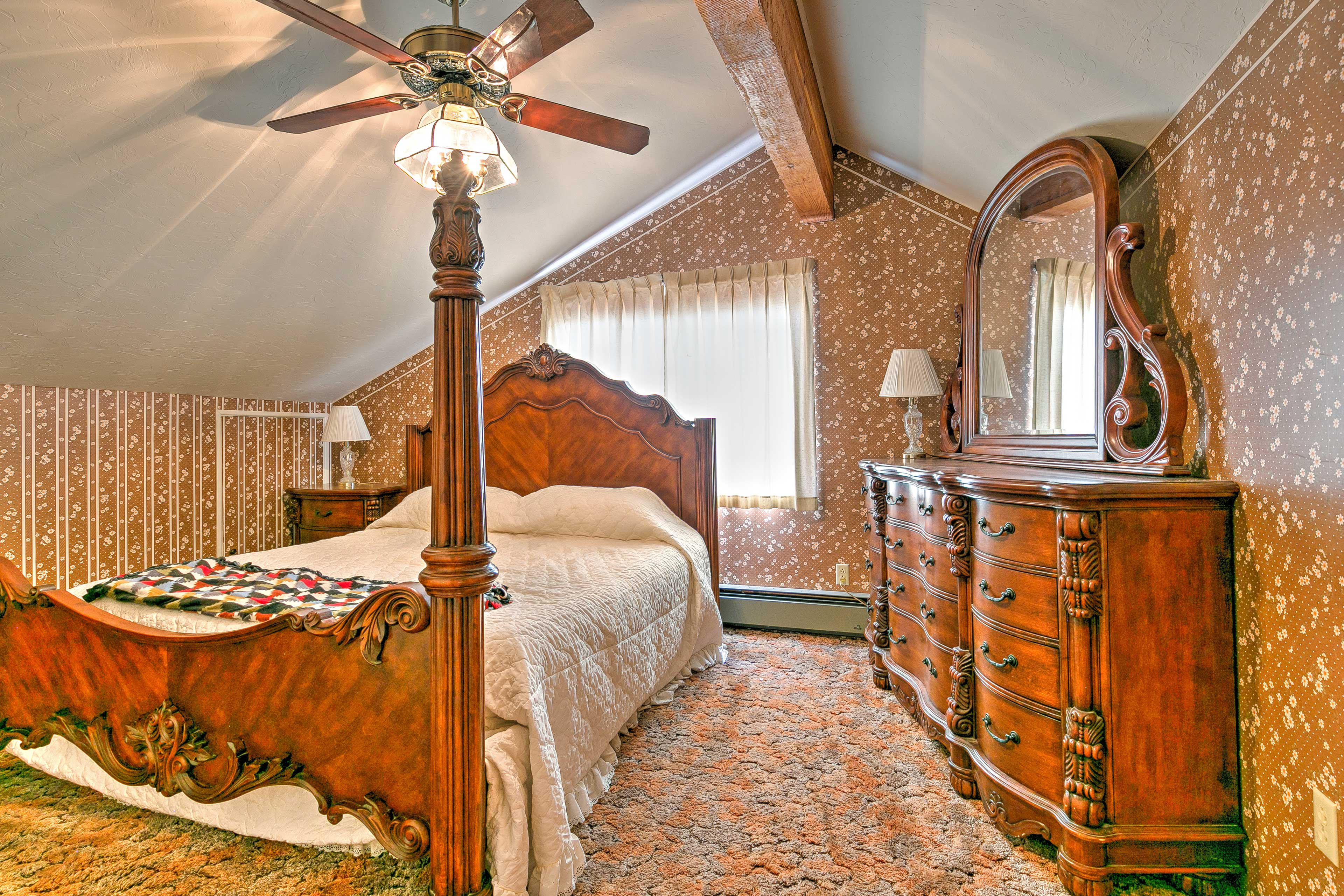 The master bedroom features a plush king-sized bed.