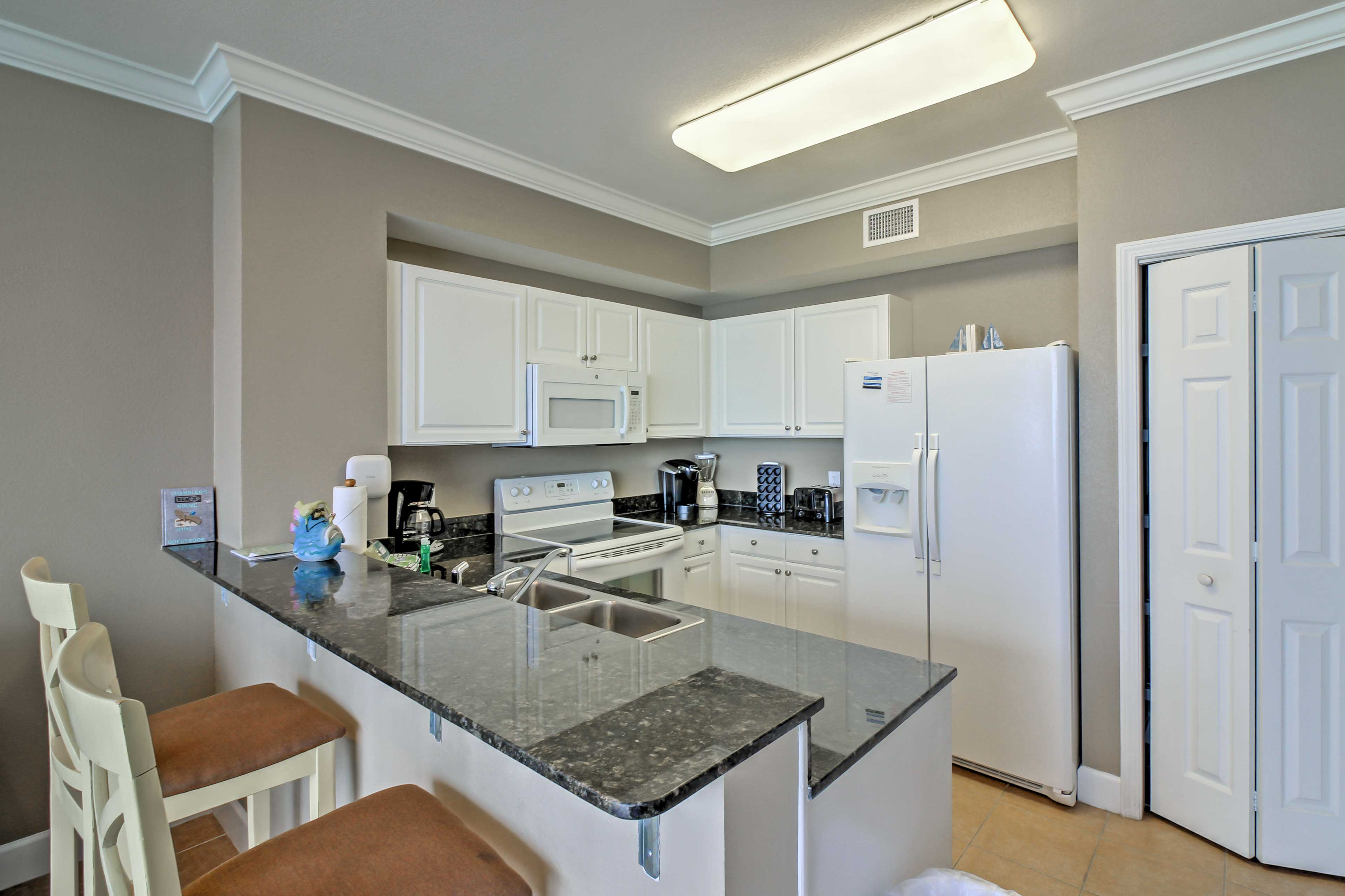 The quaint breakfast bar in the fully equipped kitchen provides seating for 2.