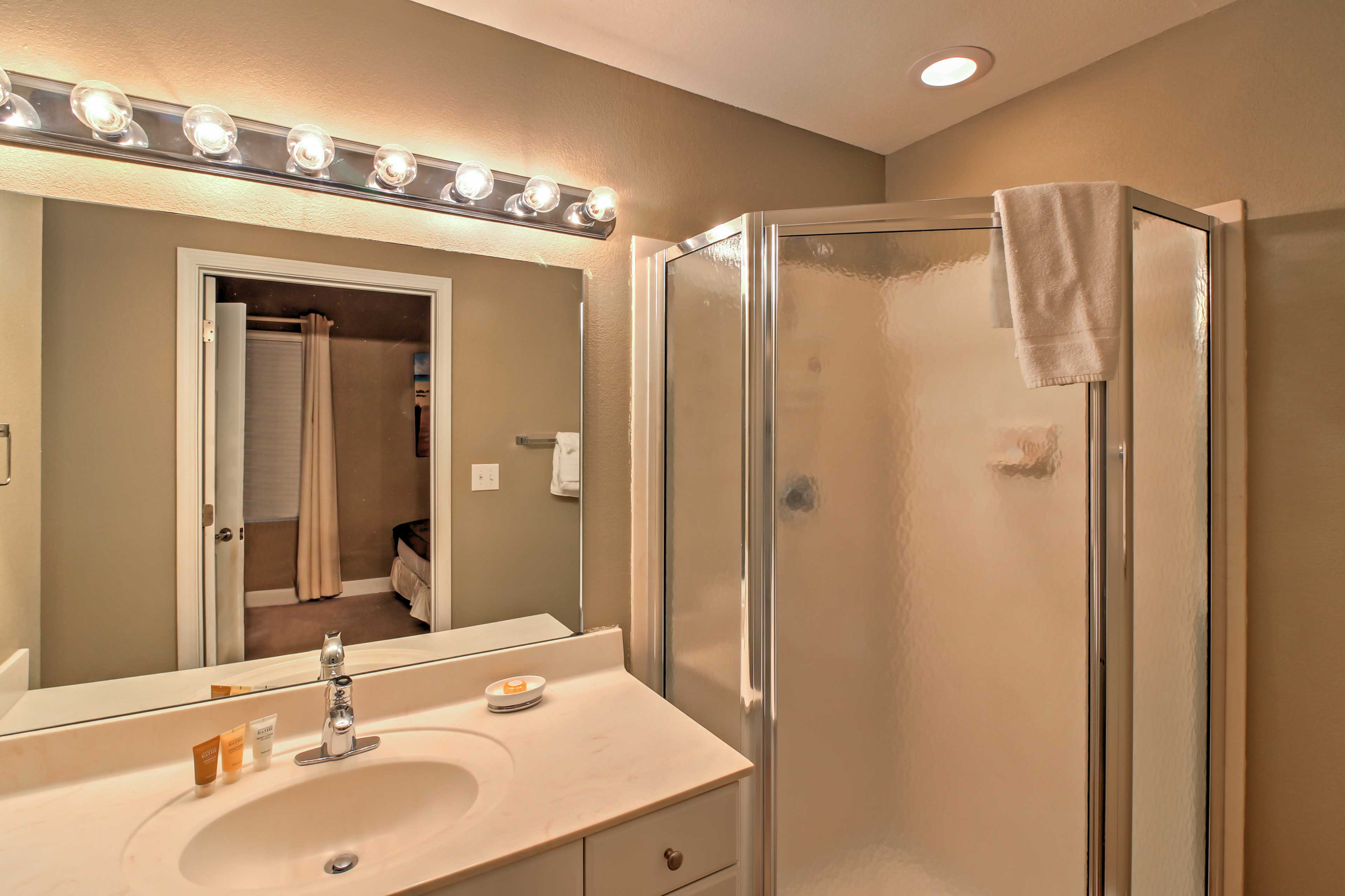 The master bedroom features an en suite bathroom with a glass walk-in shower.