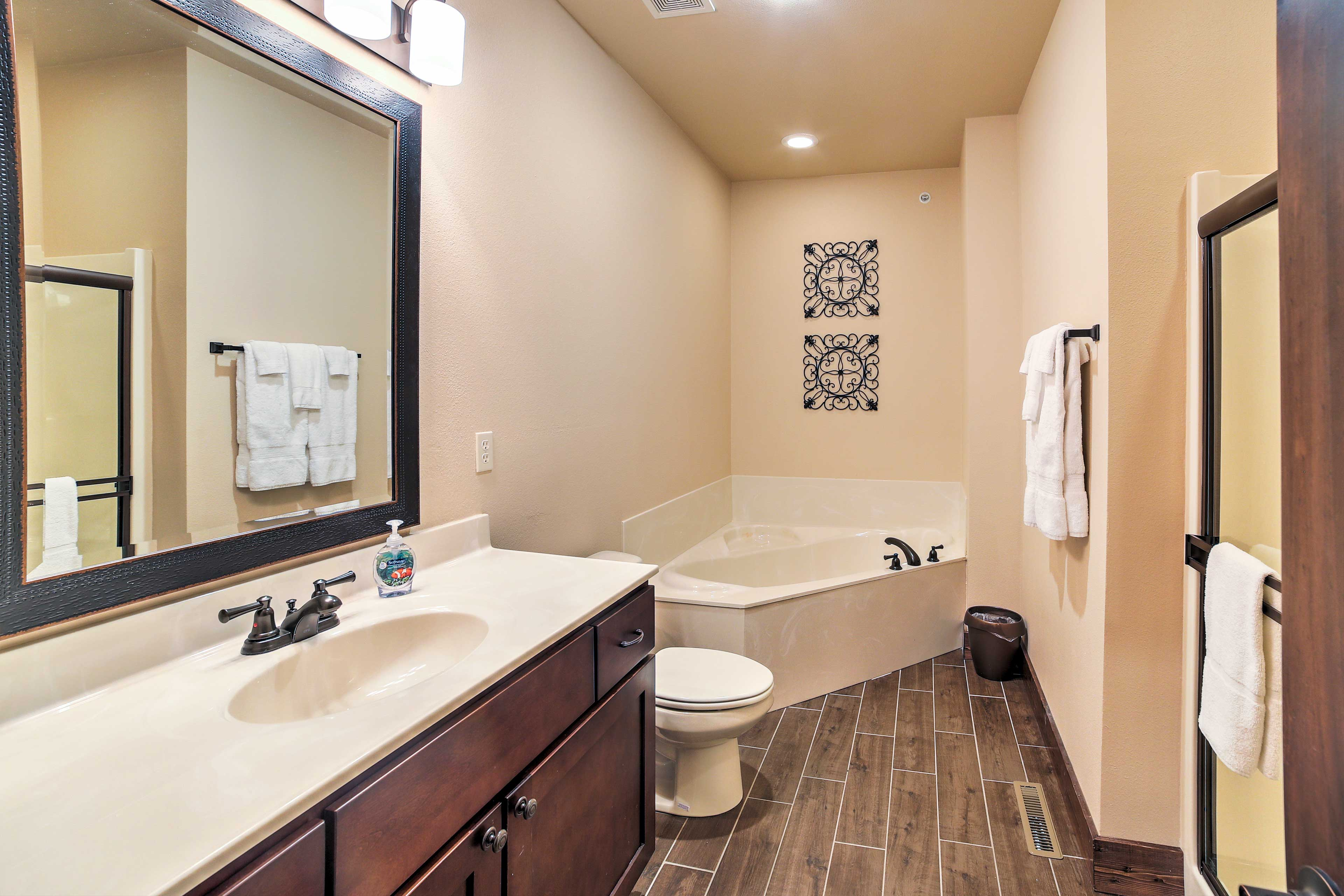 Take a soothing bath in the jetted Jacuzzi in this full bathroom.