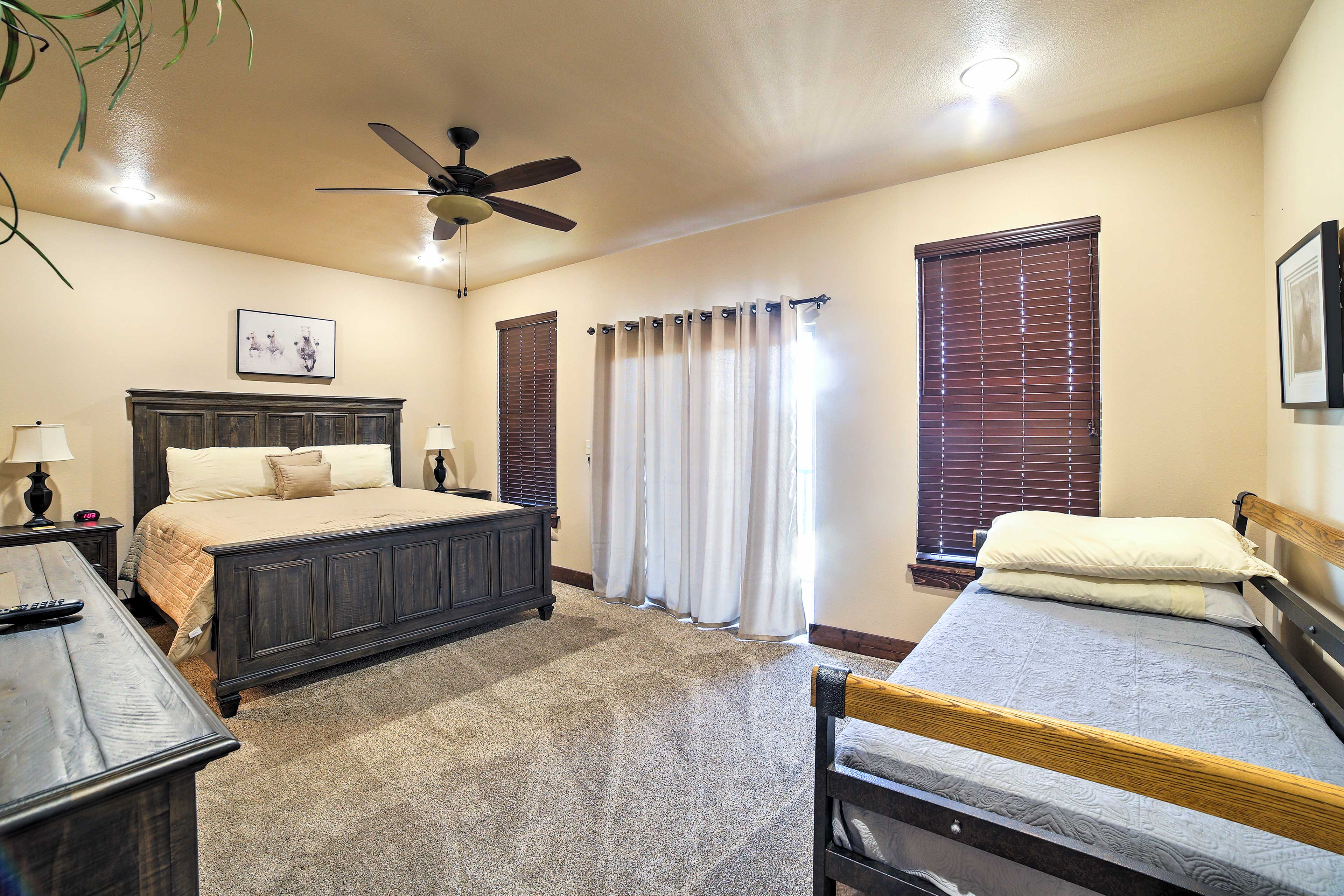 For restful slumbers, head into this bright and fashionably decorated room with a king-sized bed and twin  bed with a twin trundle.
