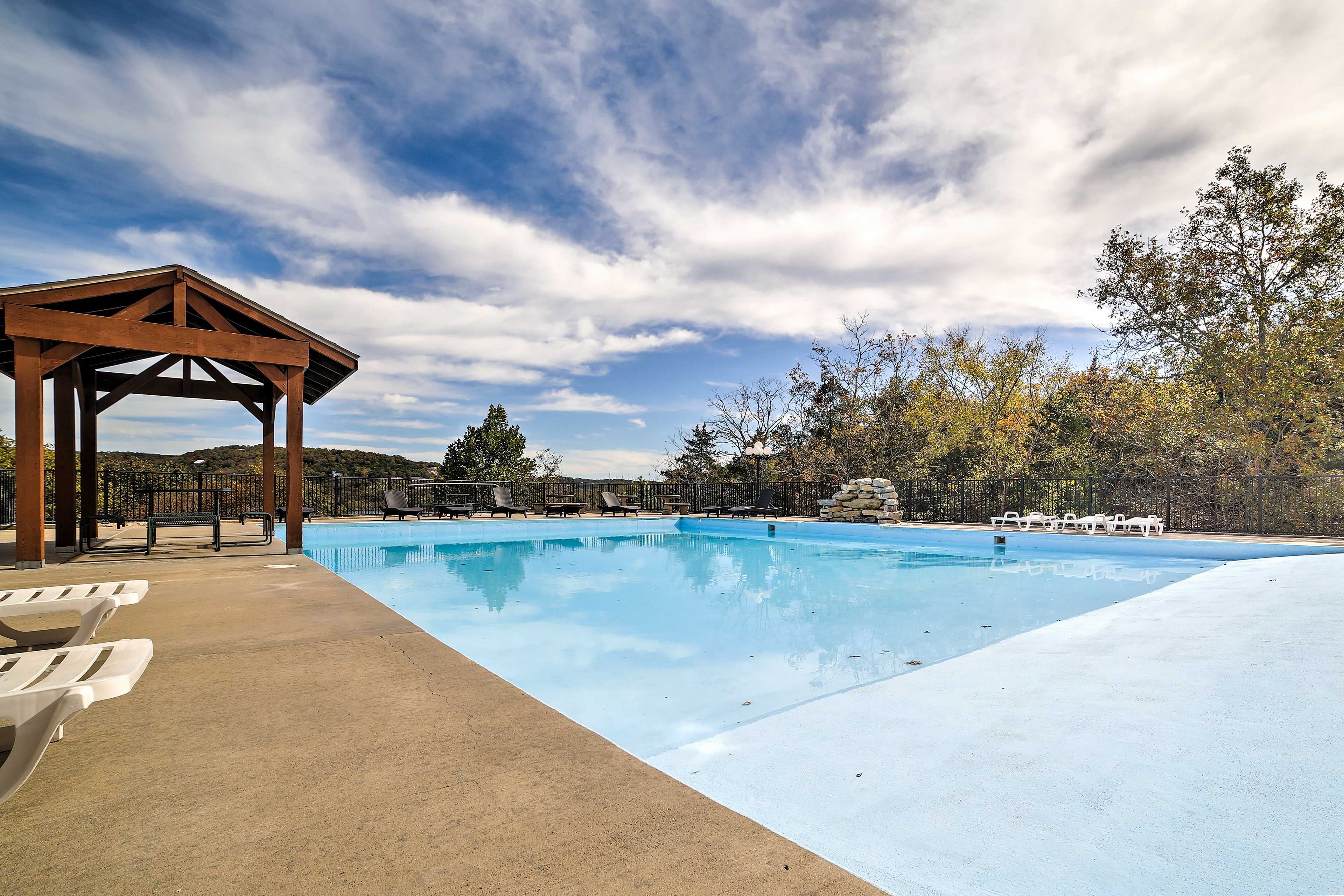 Just steps from your front door is the shared pool for swimming and sunbathing!