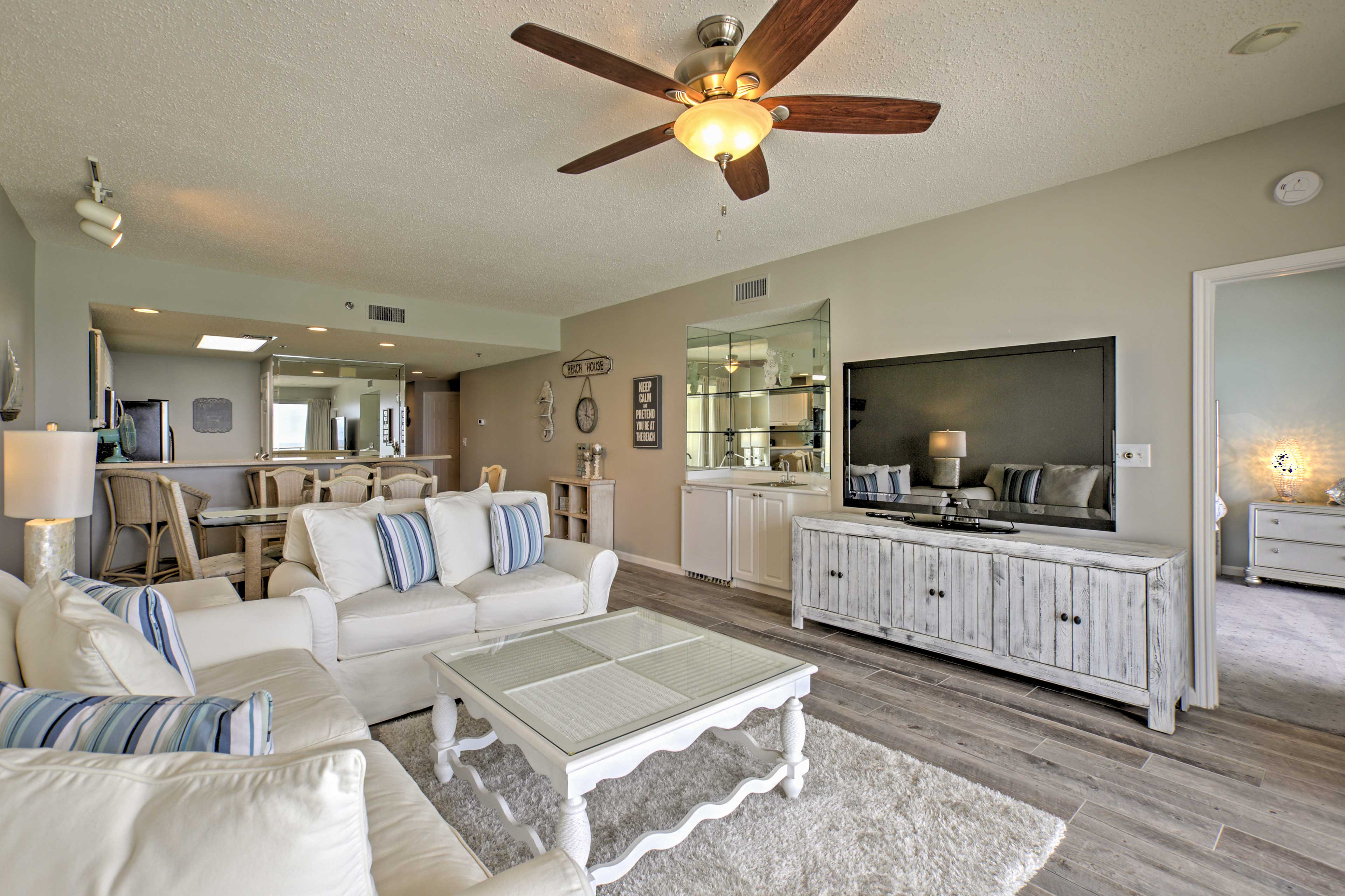 his charming, open concept living area features 2 couches and a TV.