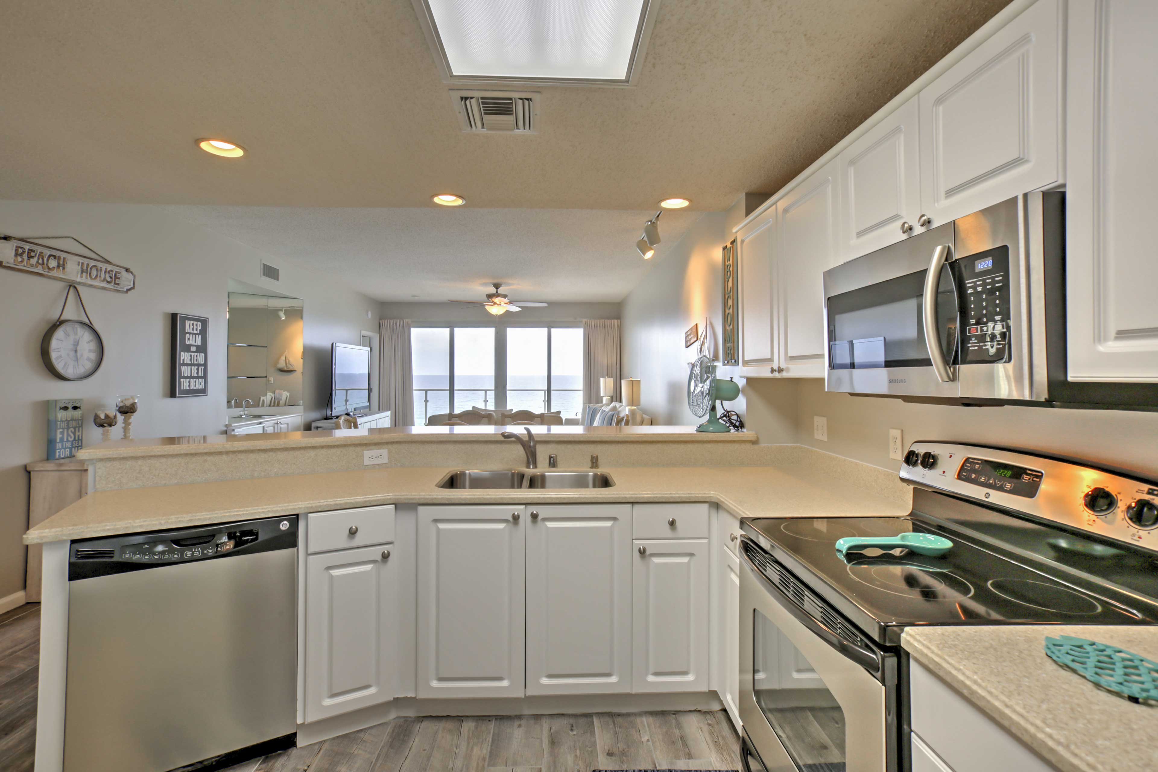 The fully equipped kitchen offers stainless steel appliances, and breakfast bar.