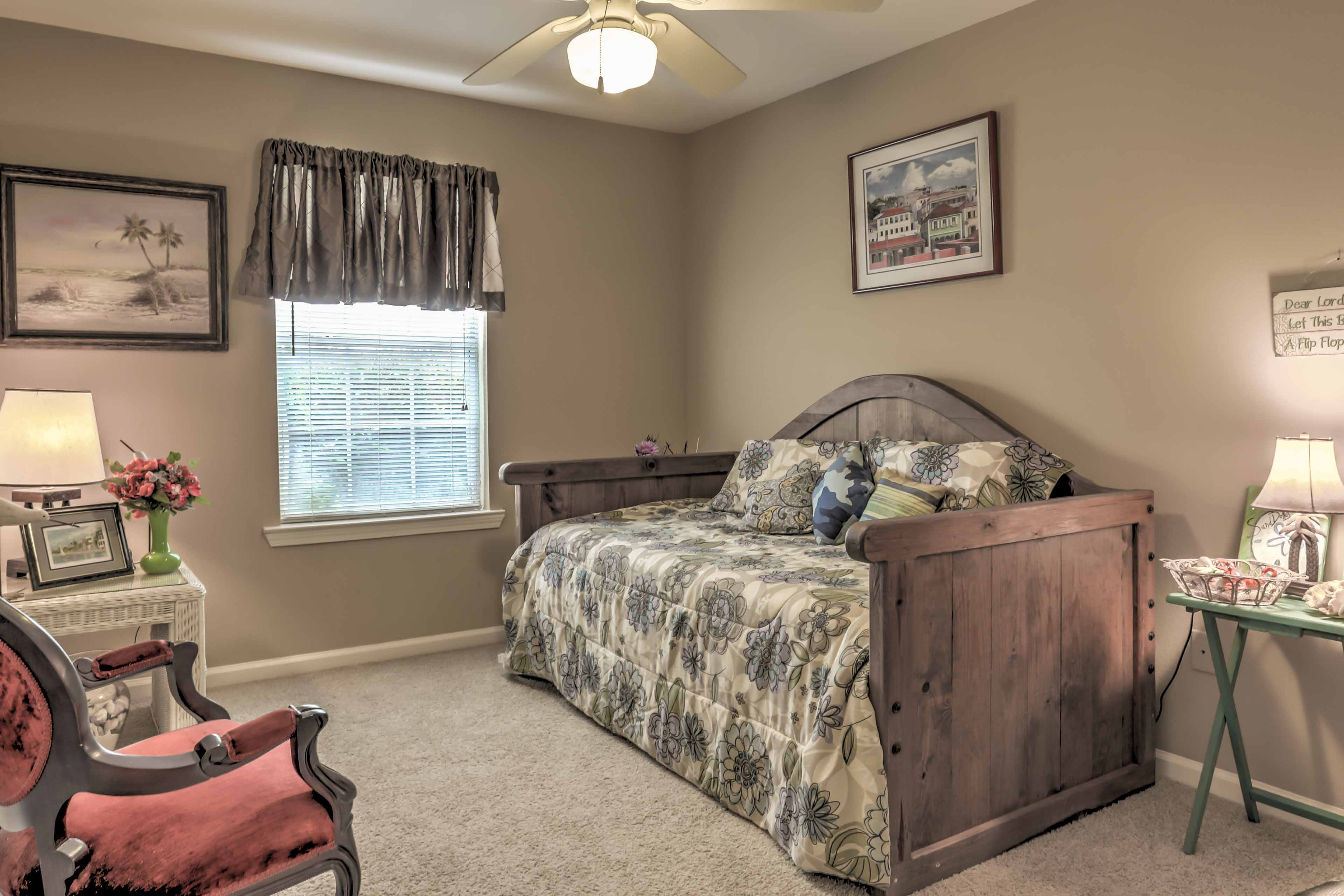 This bedroom features a twin-sized day bed.