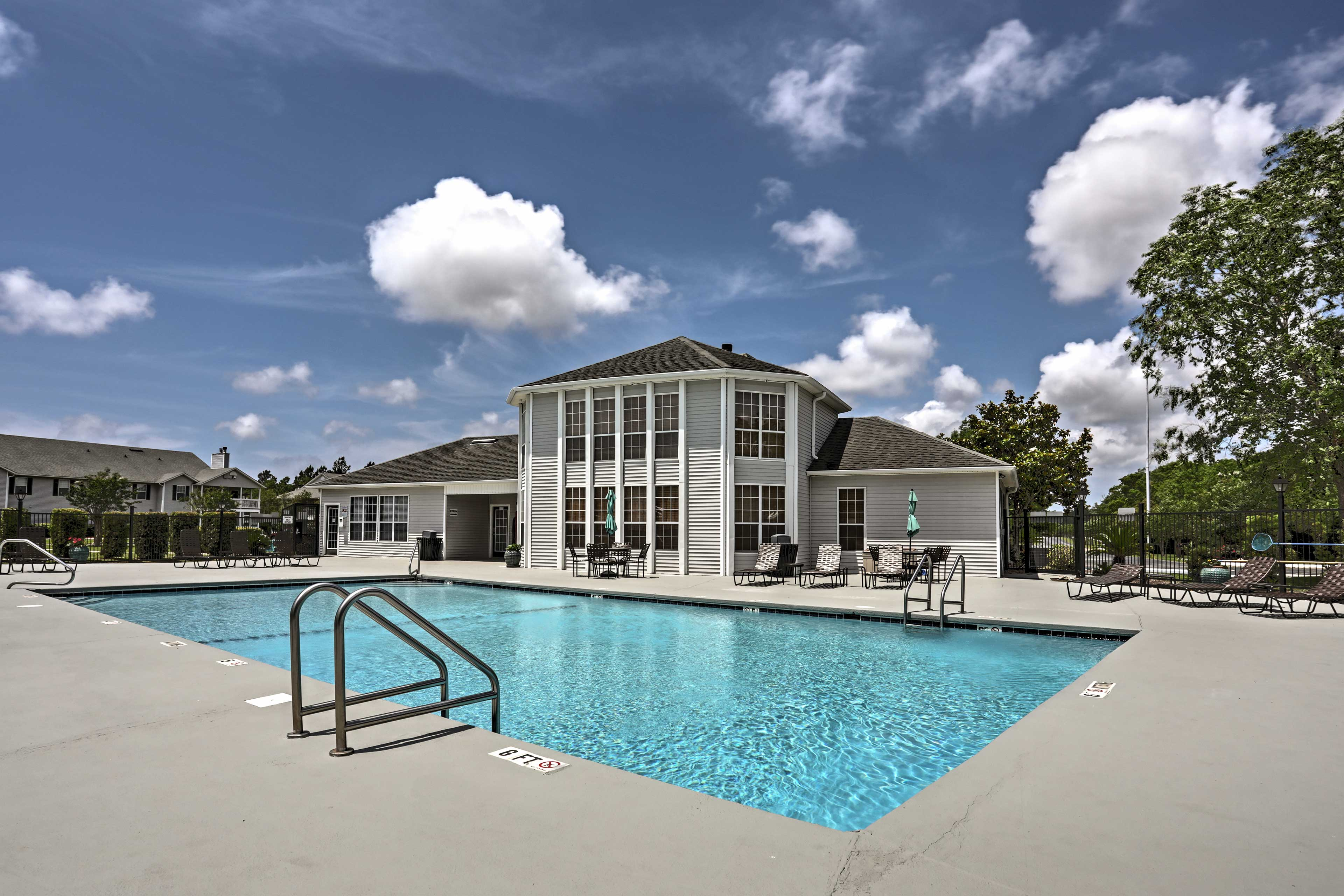 Take a dip in the community outdoor pool to cool off from the summer heat.