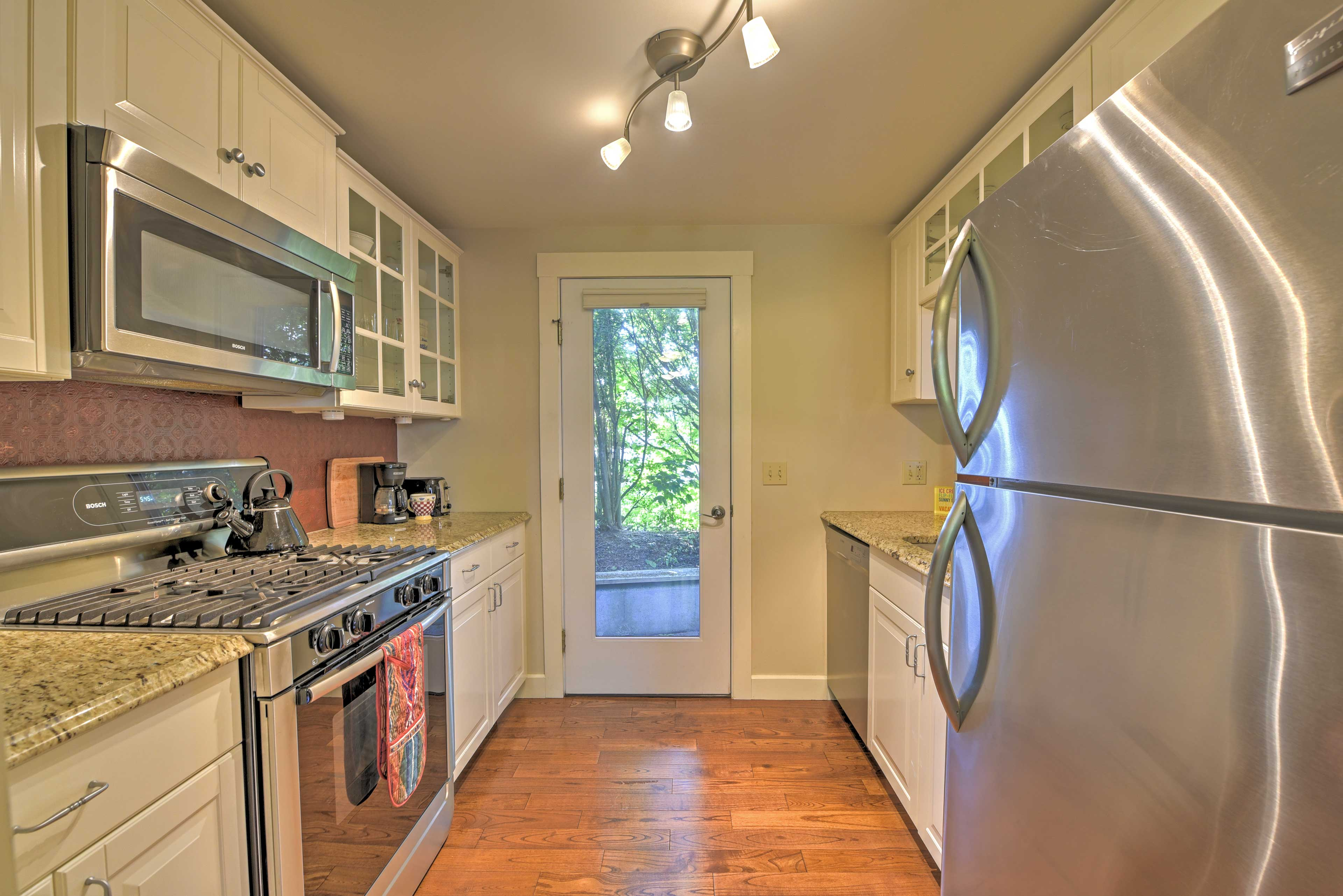 The fully equipped kitchen features Bosch stainless steel appliances.