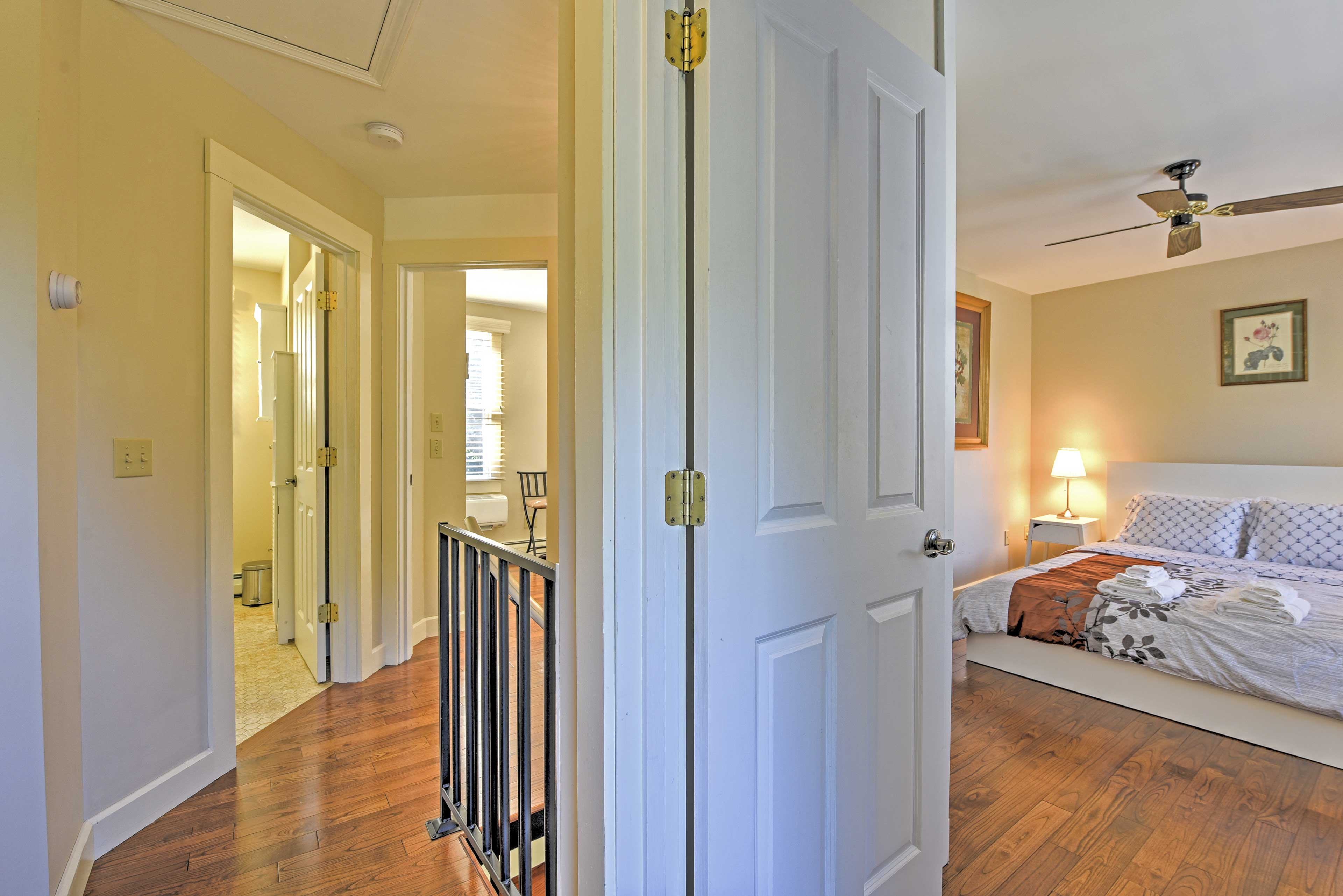 Two comfortable bedrooms are located on the upper level.