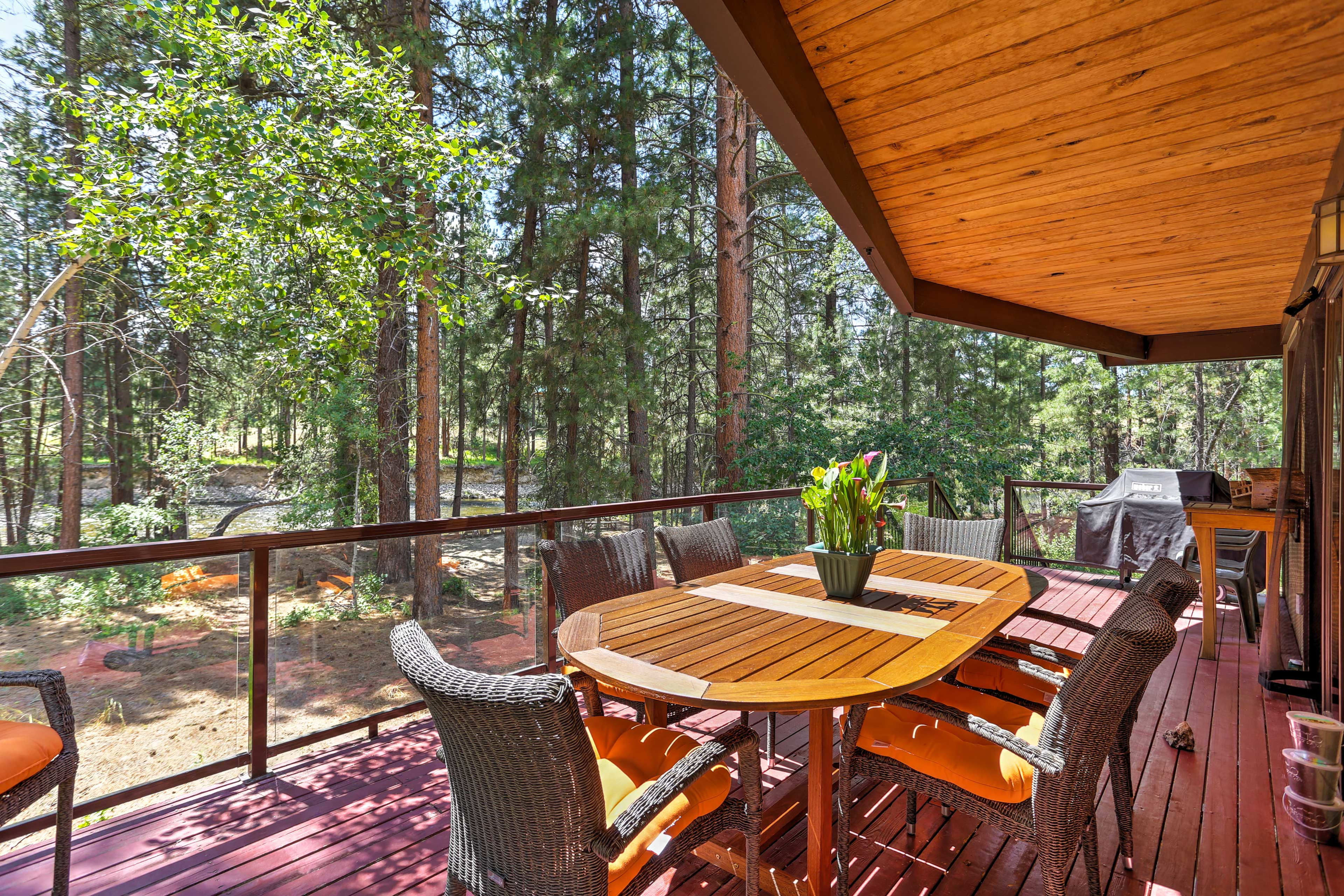 Relax on the back deck and listen to the rushing Chewuch River.