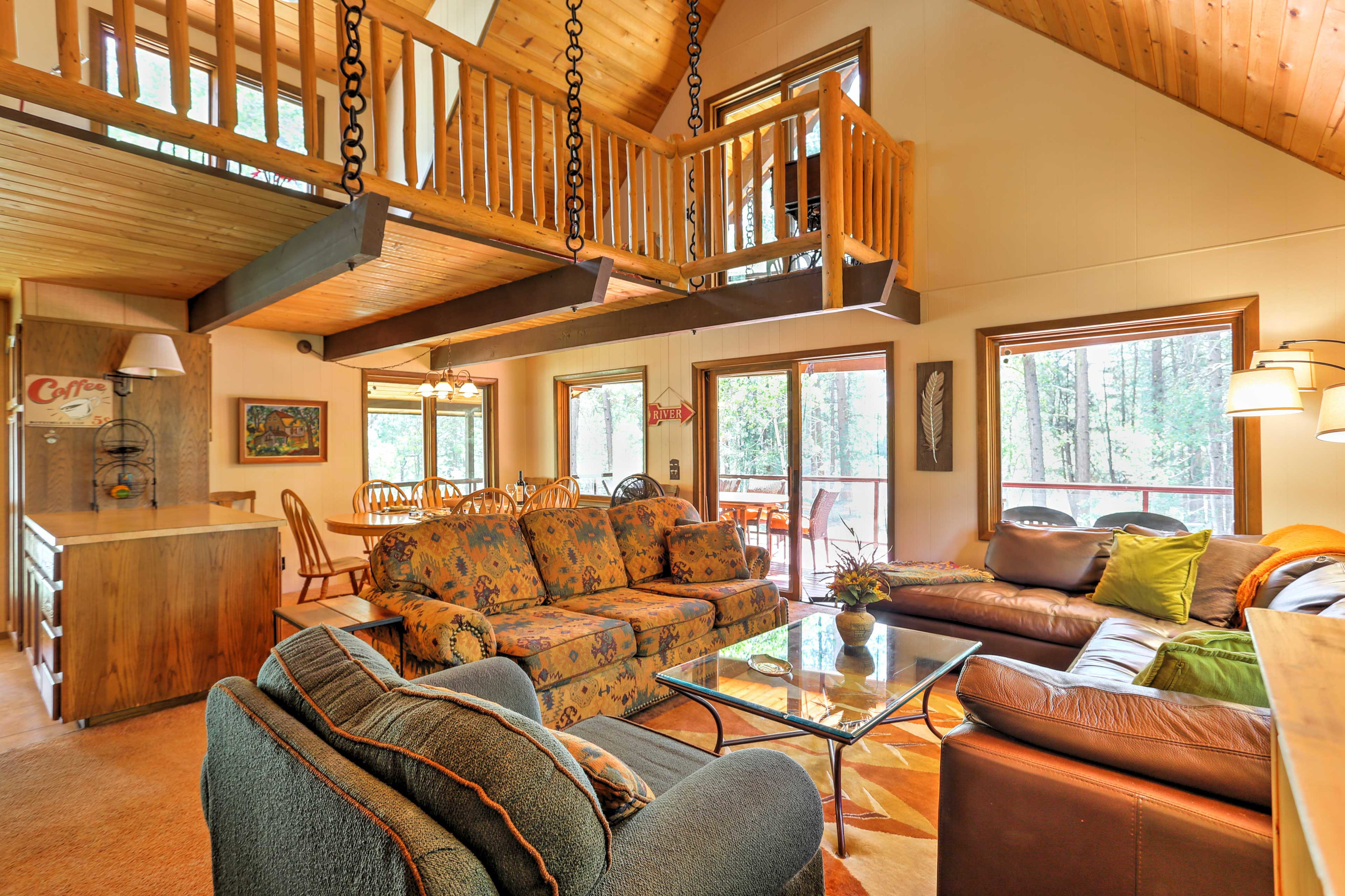 The spacious interior features vaulted, knotty pine ceilings and bark beams.