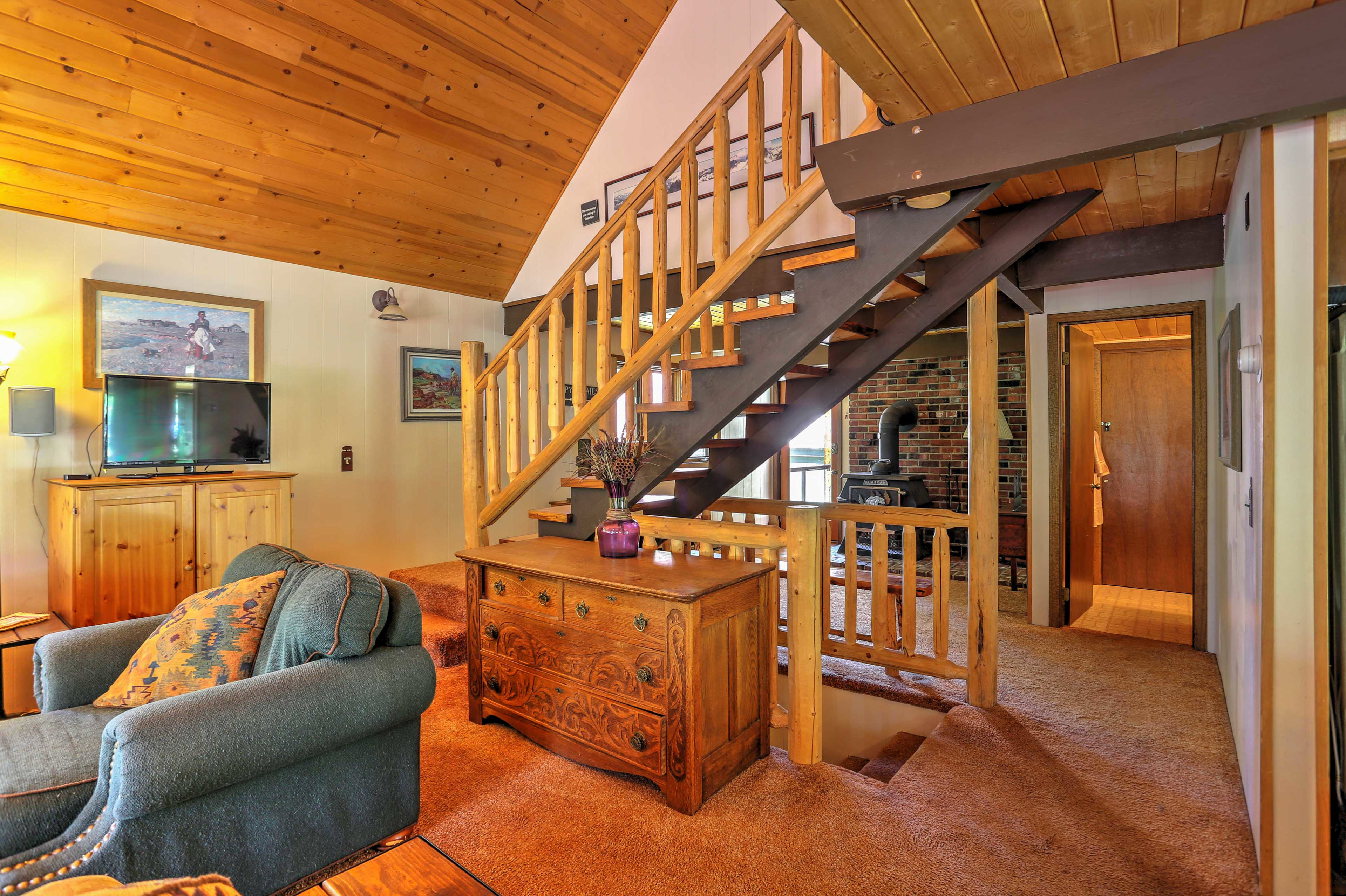 The cozy interior has a rustic aesthetic.