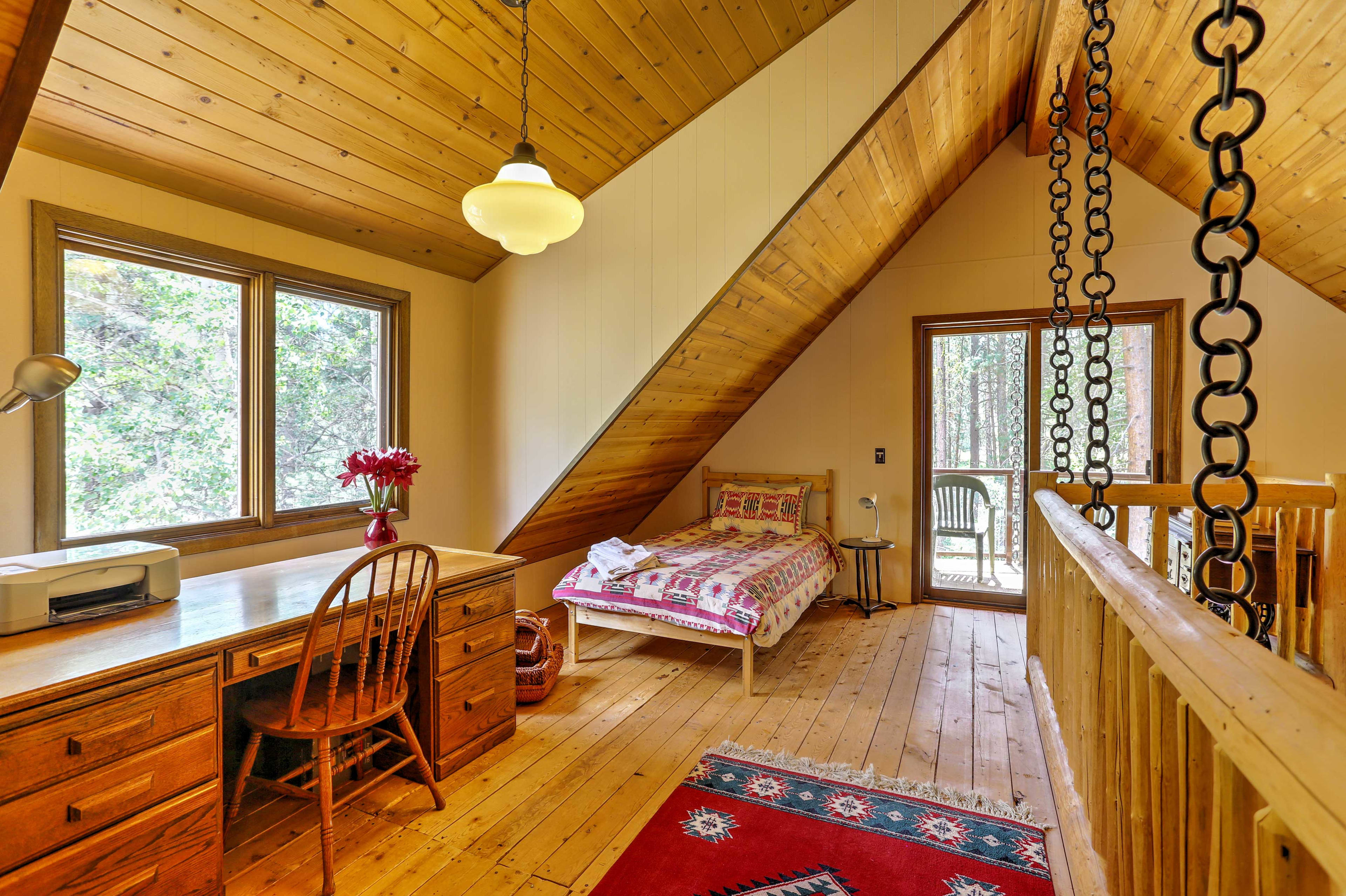 Head up to the loft where a guest can sleep in the twin-sized bed.