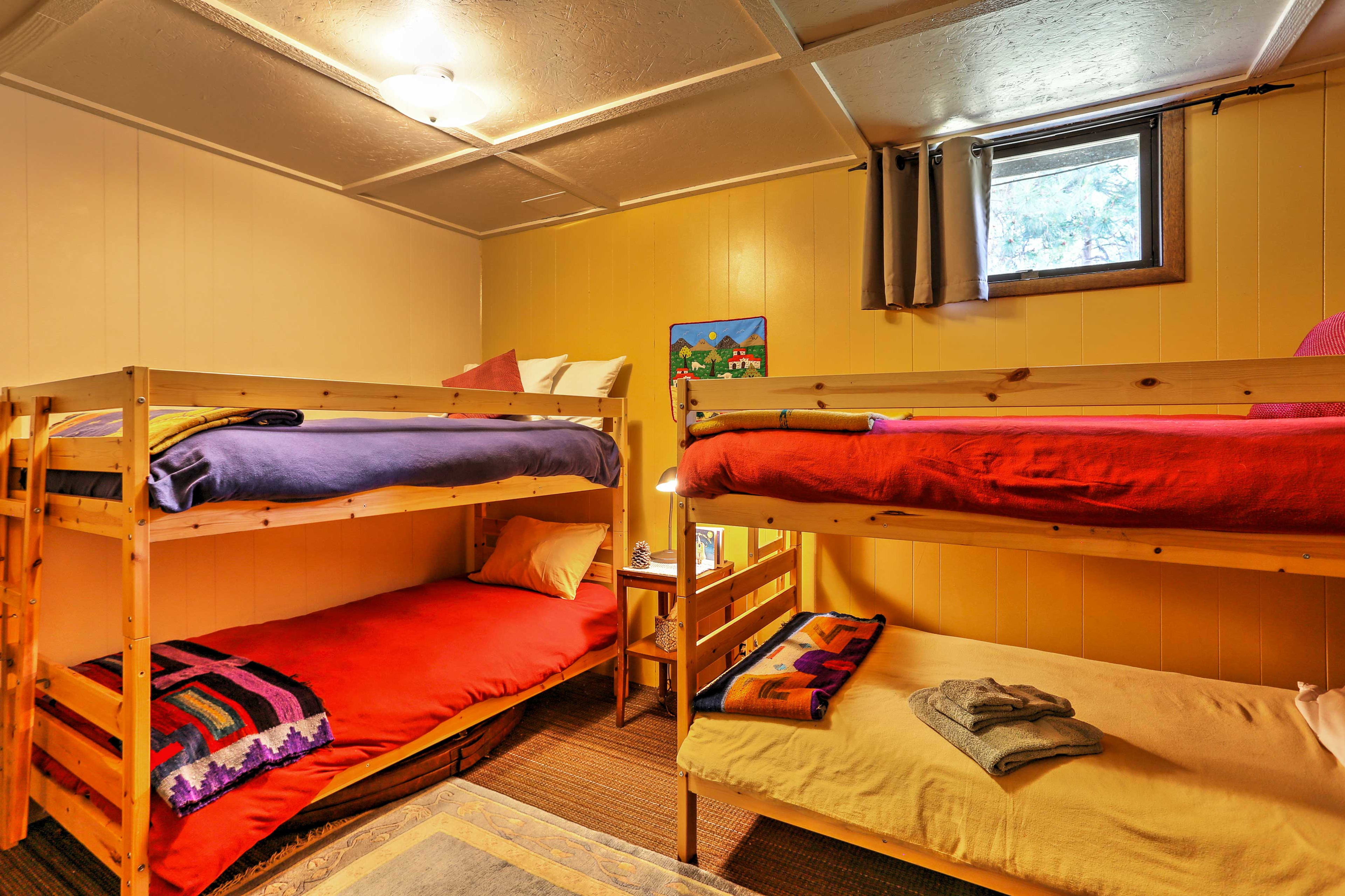 Four guests can sleep in the third bedroom, which has 2 twin-over-twin bunks.
