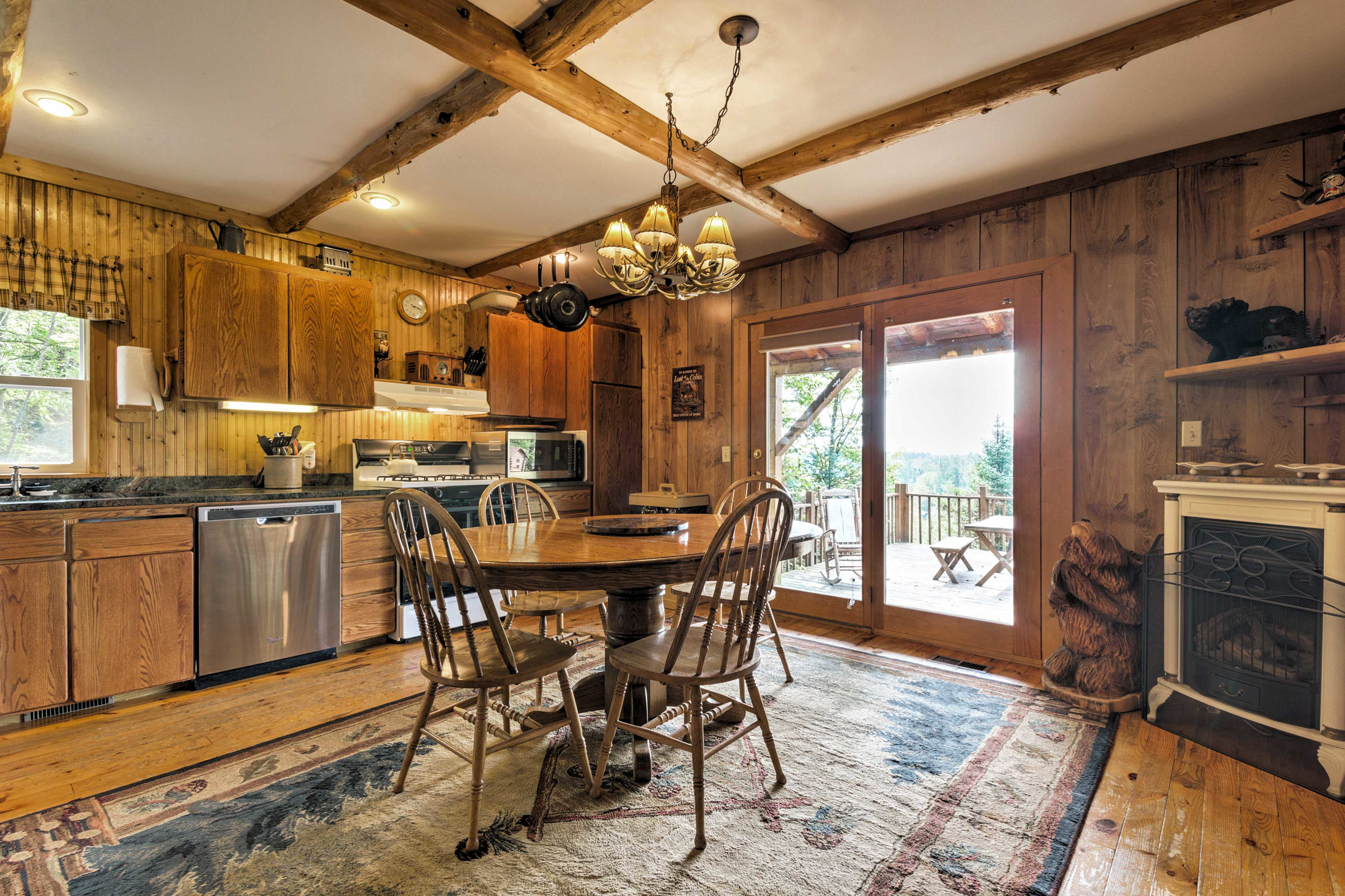 The kitchen has sliding glass doors that open up to the deck.