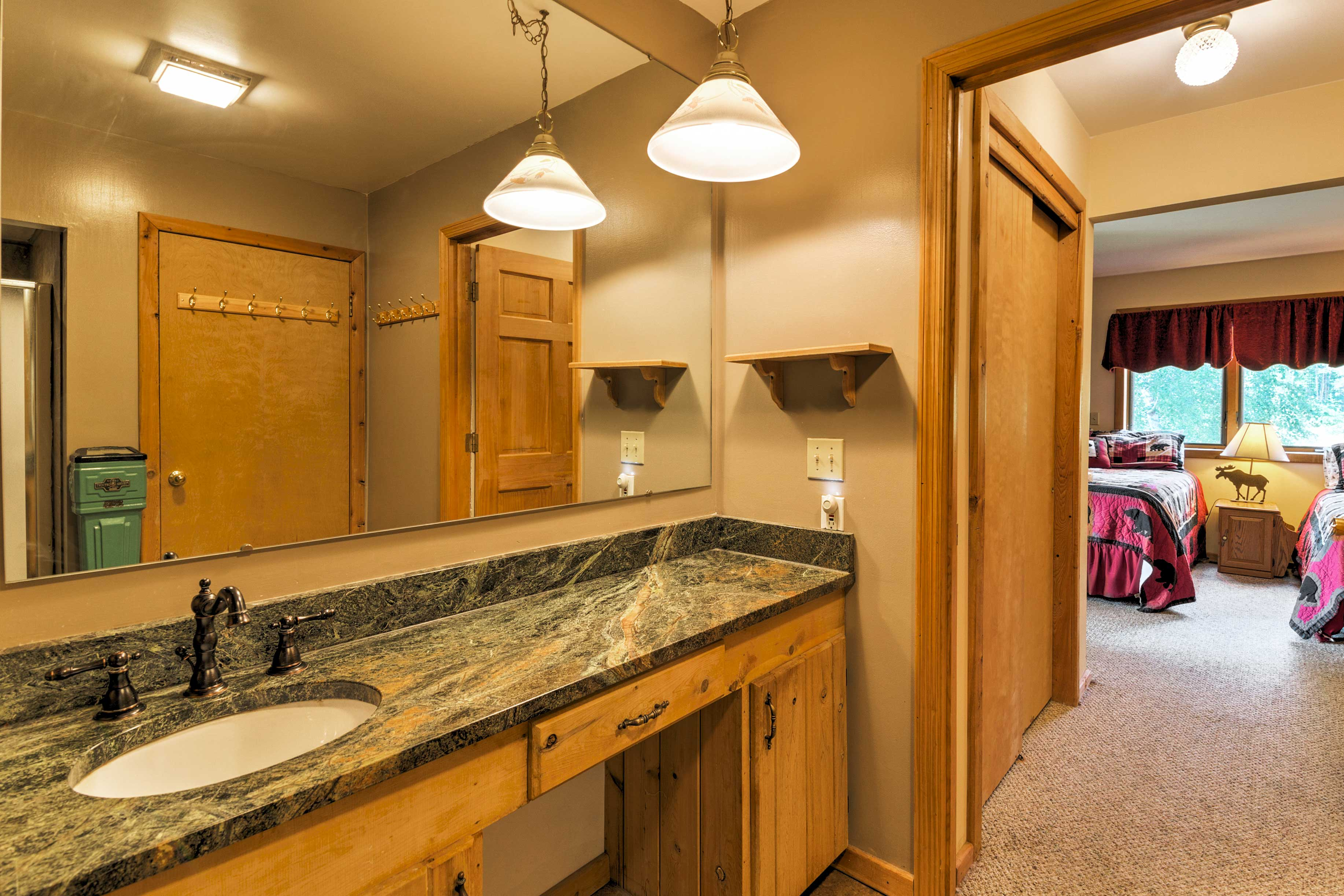 The bathroom also features beautiful granite countertops.
