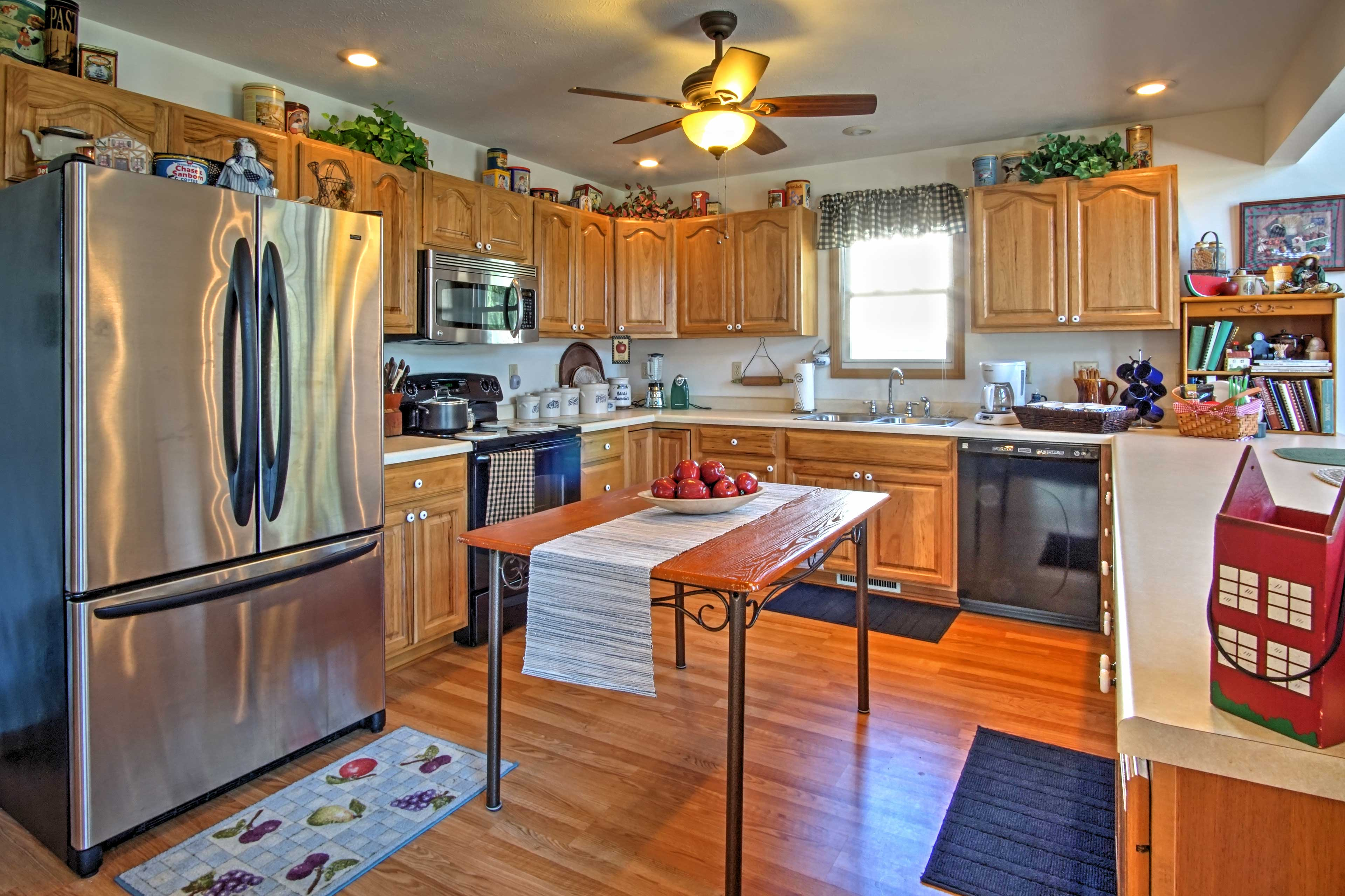 The kitchen includes all your essential appliances and a breakfast bar.