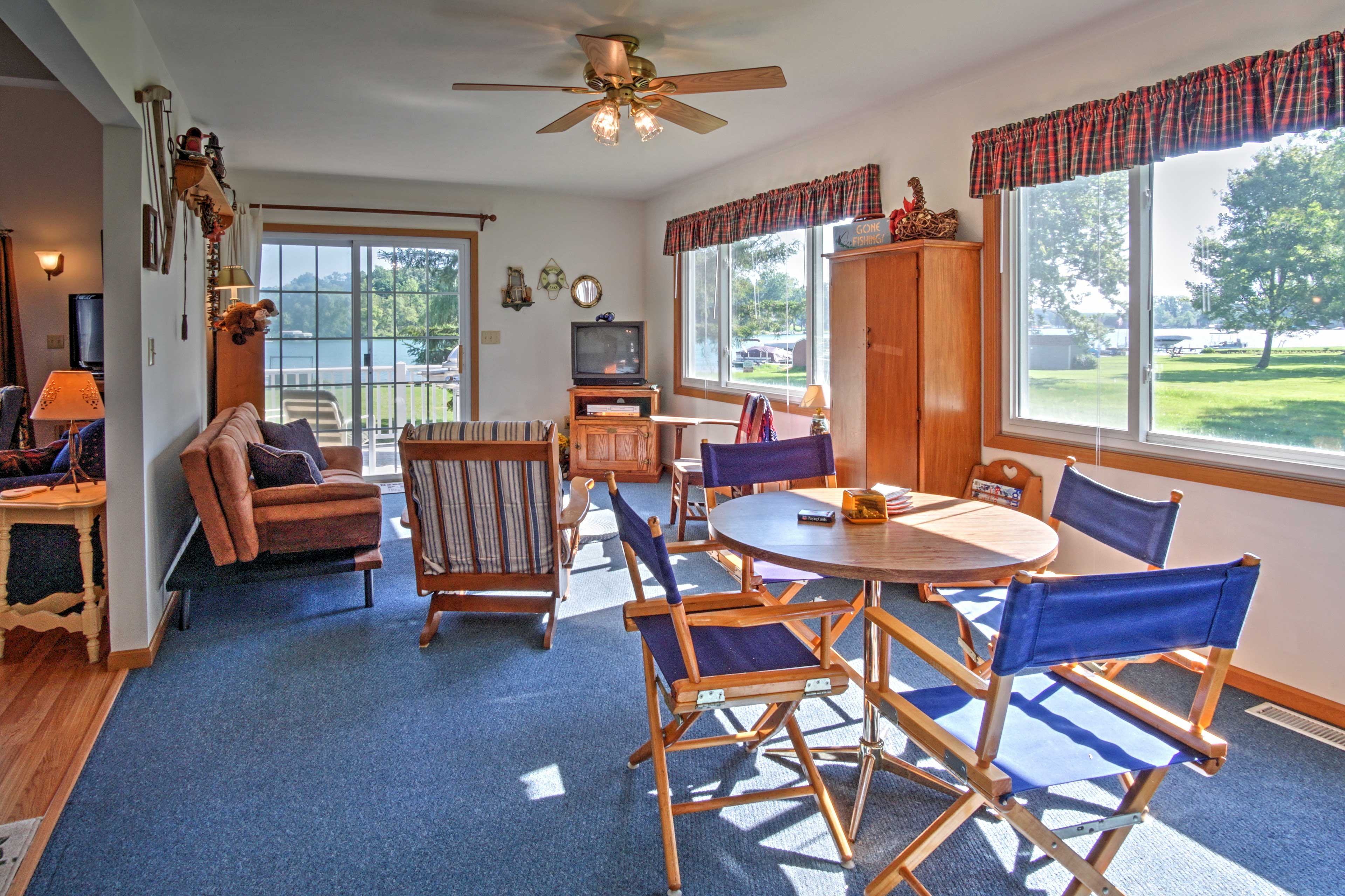 The game room offers views of the lake, board games, furnishings and a TV.