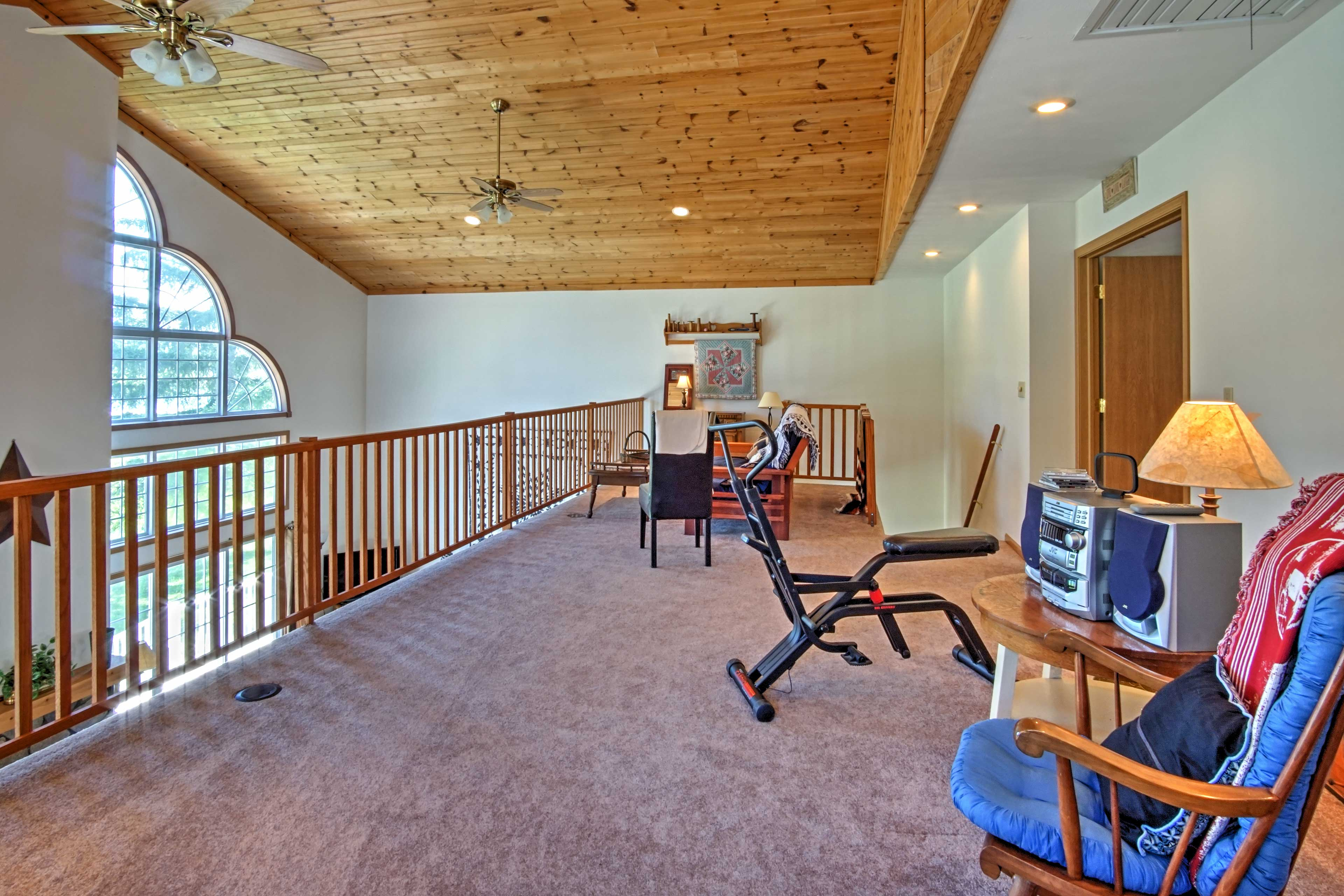 The loft area offers additional sleeping on a cozy futon.
