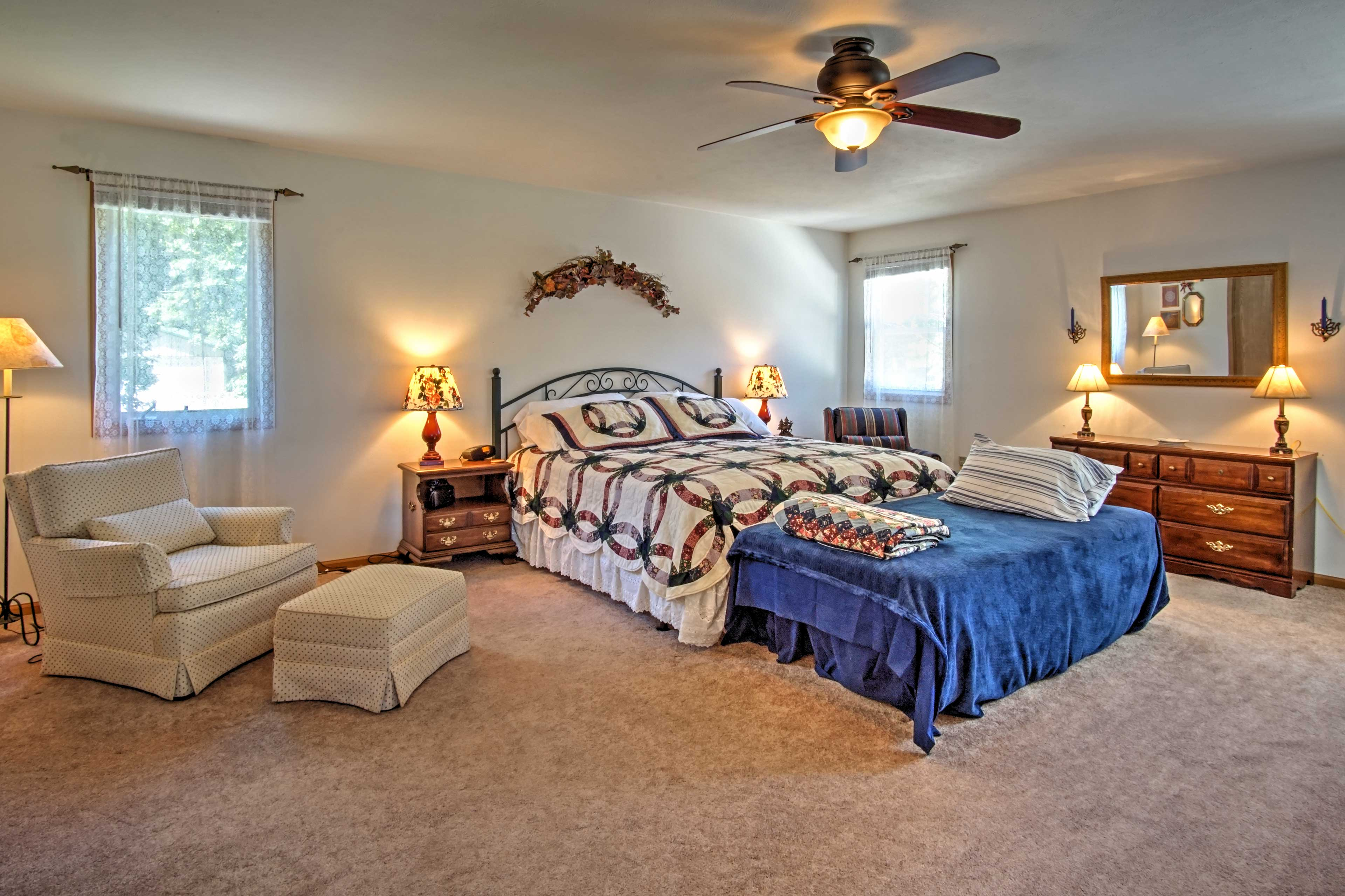 Sprawl out on the king bed in the master, which features 2 twin beds and a TV.
