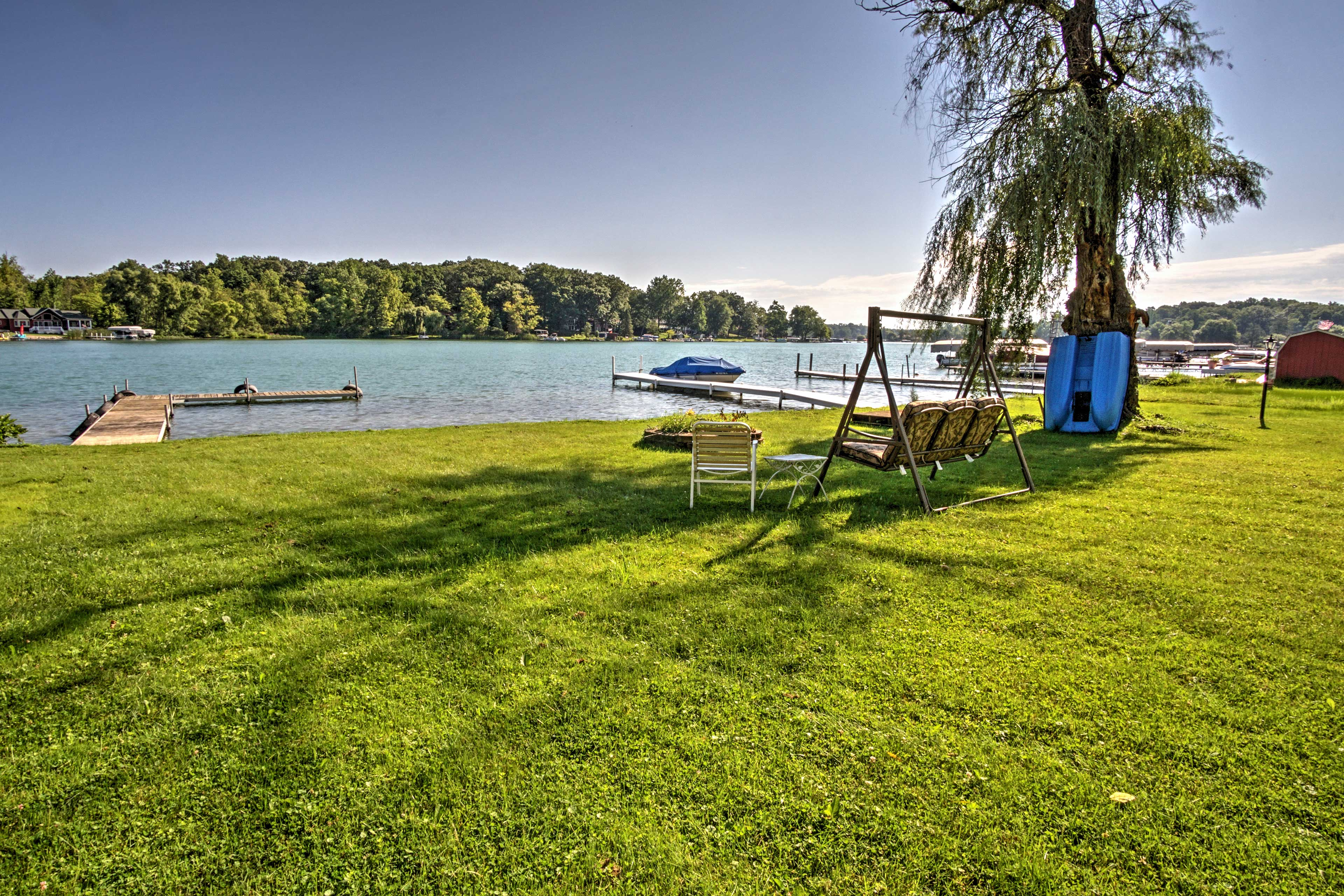 Head down to the bench swing by the water for a peaceful moment by the lake.