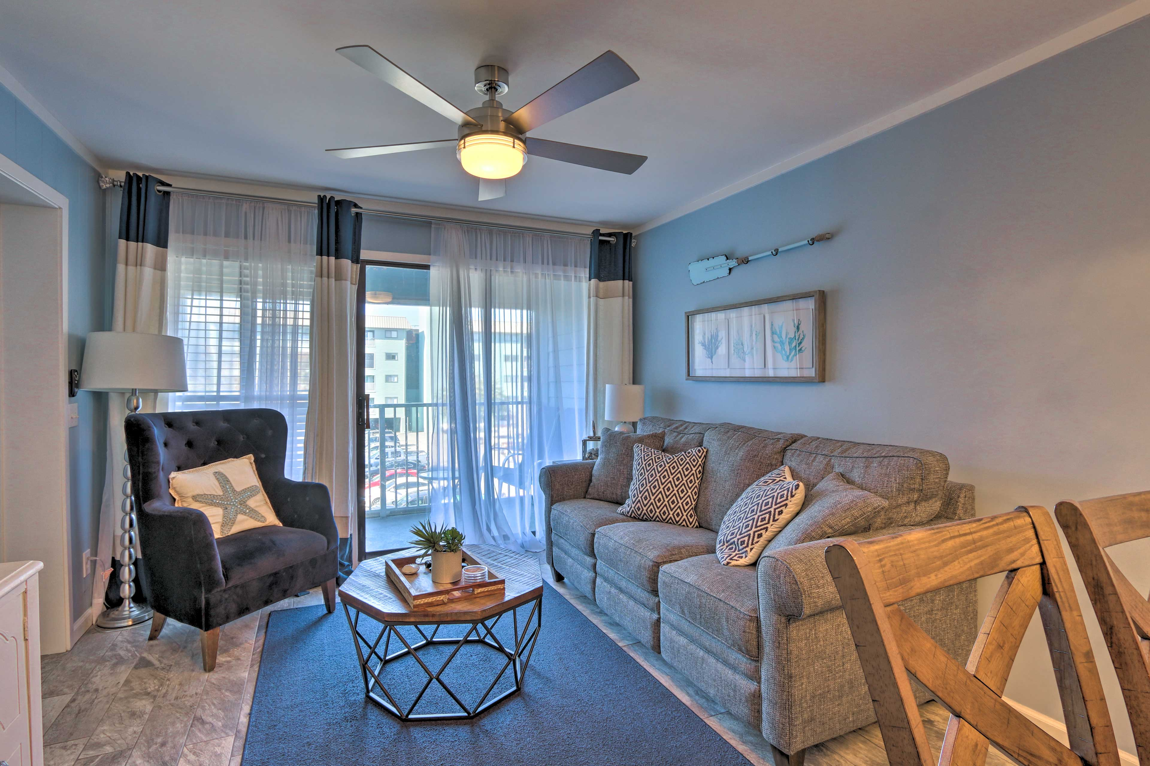 Step inside the updated condo to find bright hues and inviting beach decor.