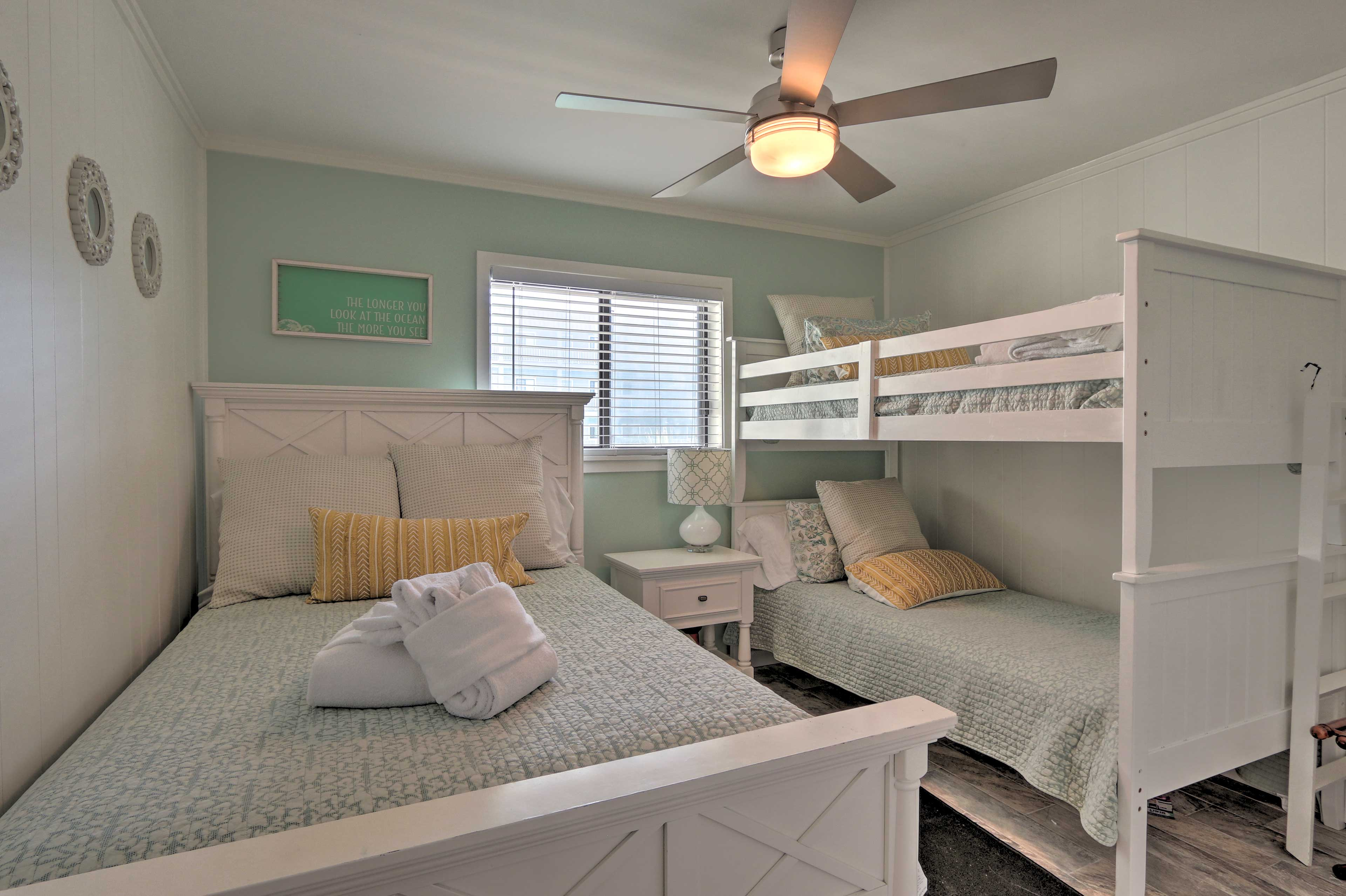 The second bedroom has a full-sized bed and a twin-over-twin bunk bed.
