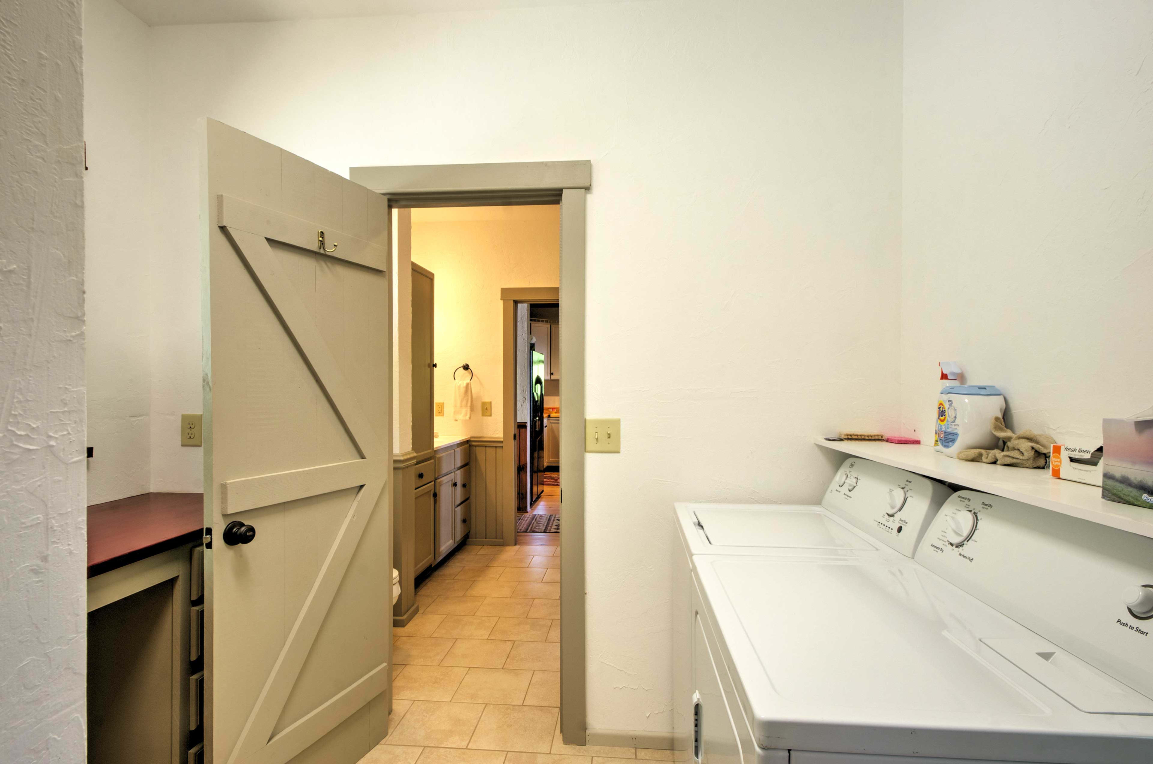 A full laundry room with storage is at your disposal.