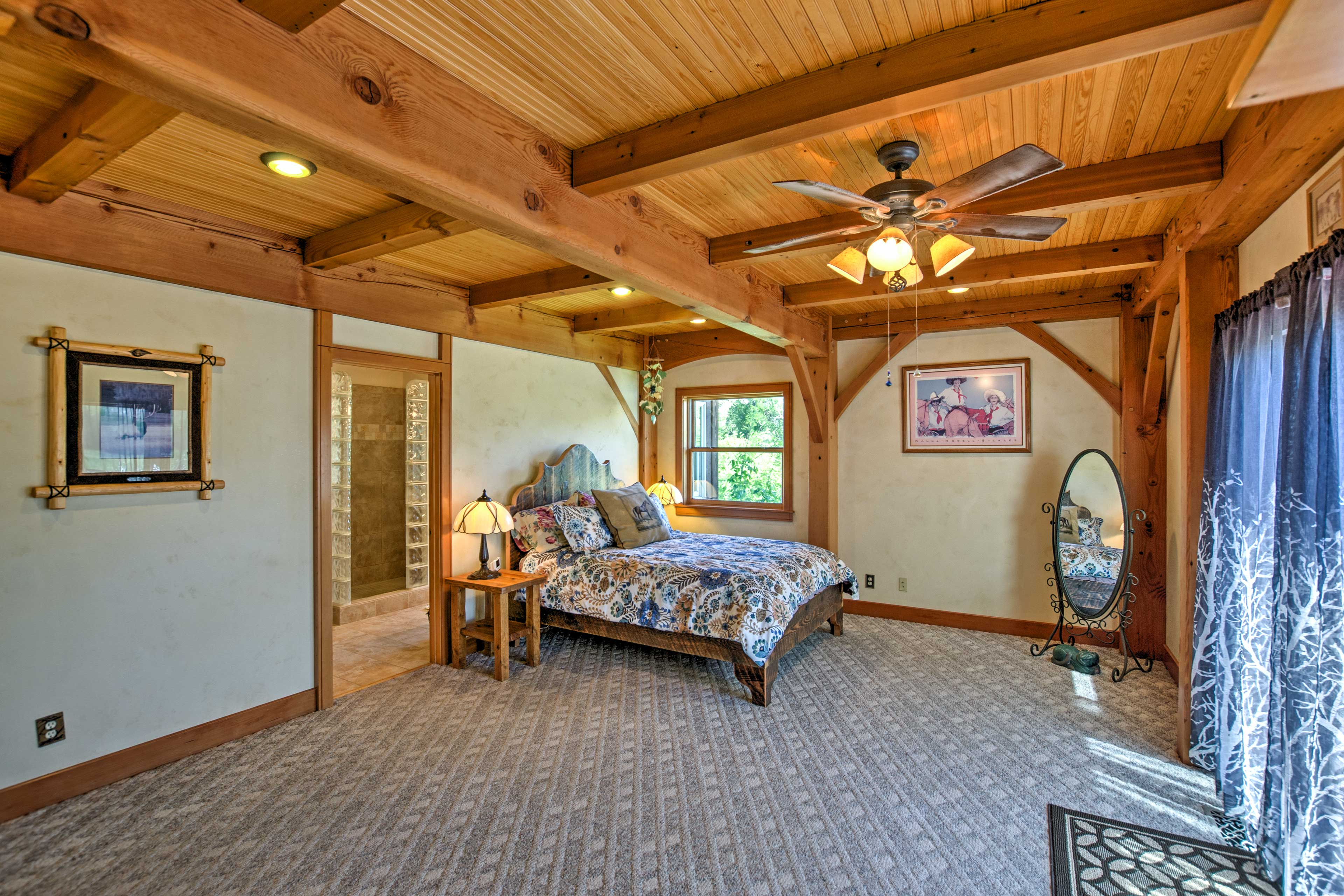 The master bedroom boasts a plush queen bed and an en-suite bathroom.