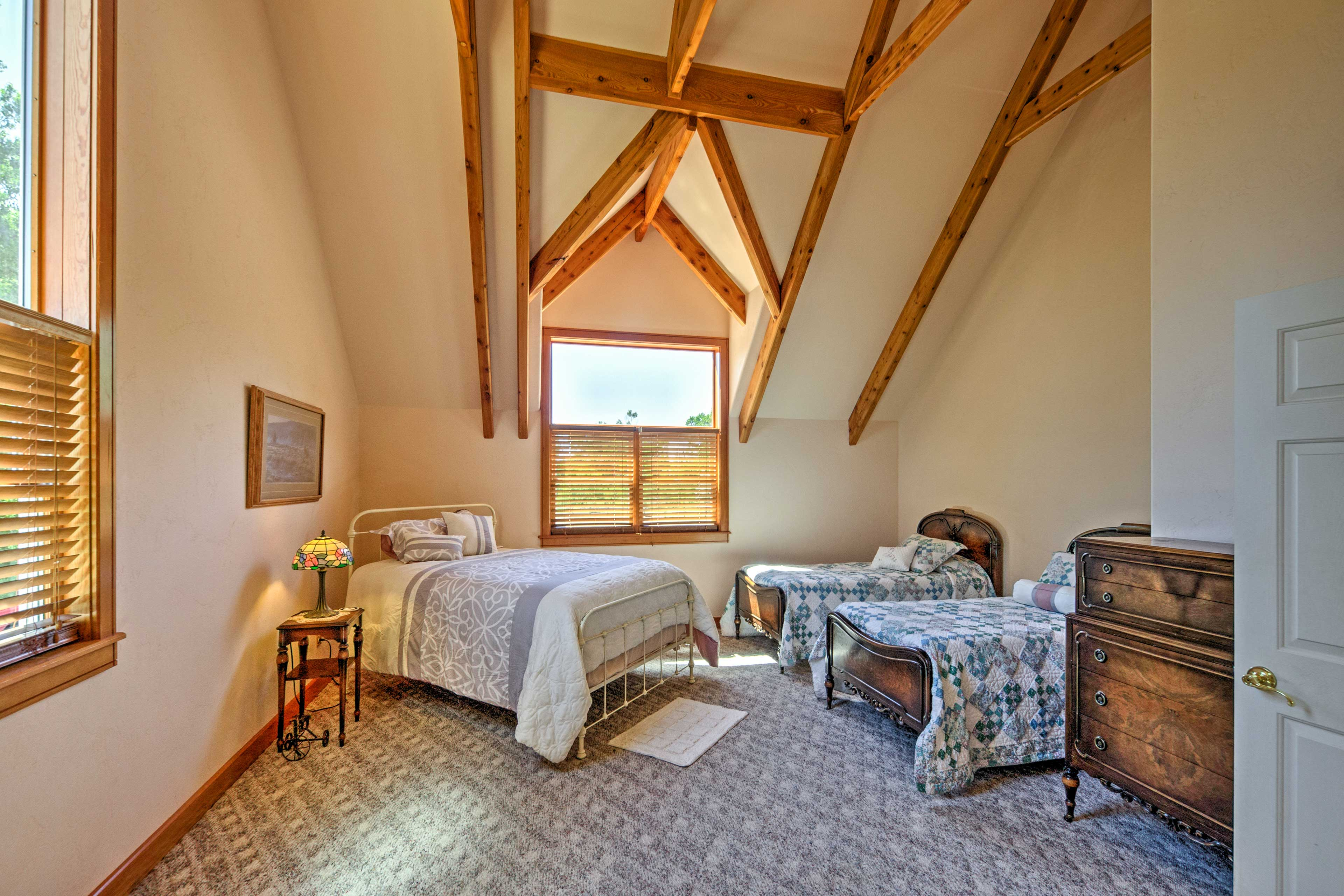 Siblings or friends will love this room featuring a queen bed and 2 twin beds.