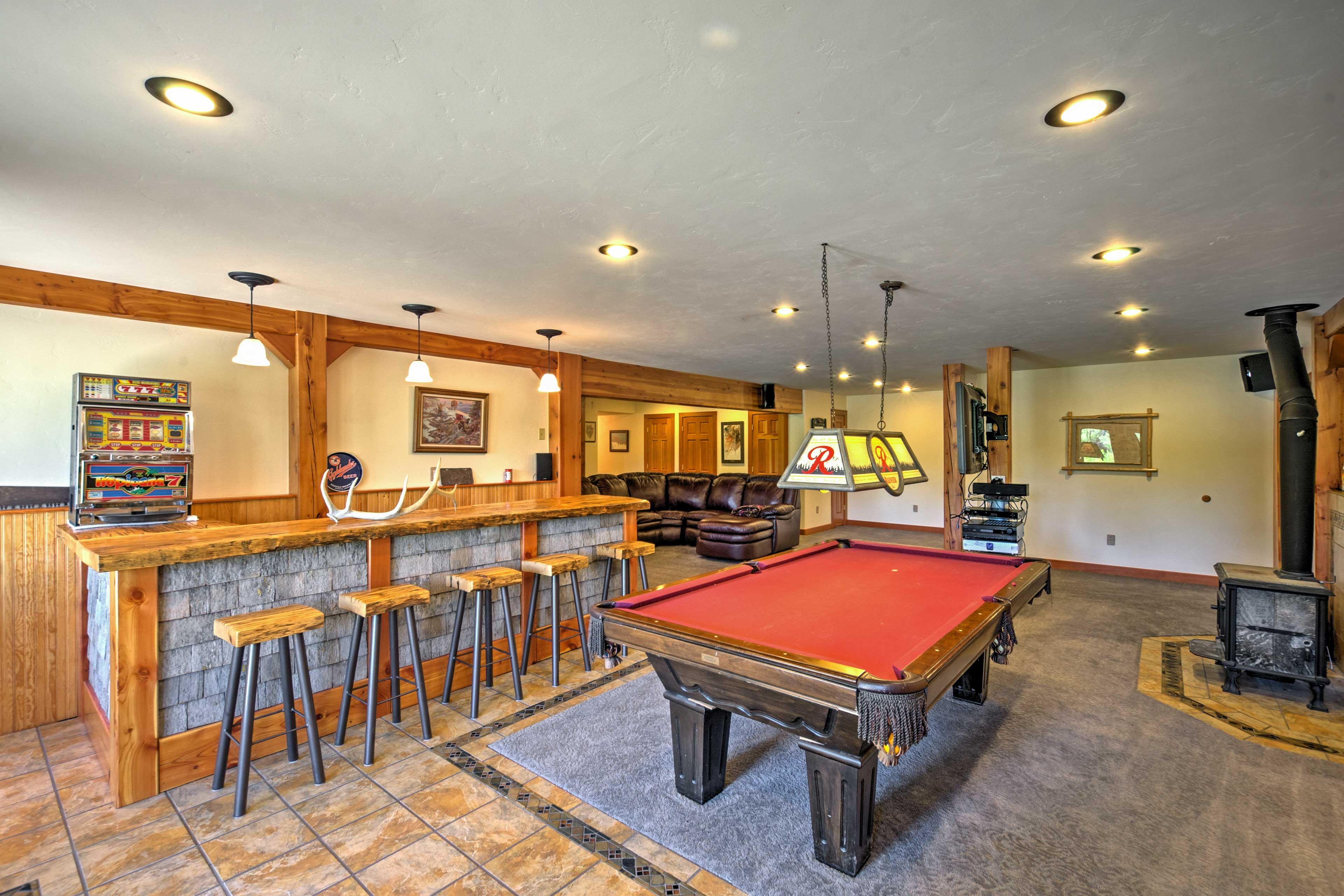 Head downstairs to watch TV or challenge your companions to a game of pool.