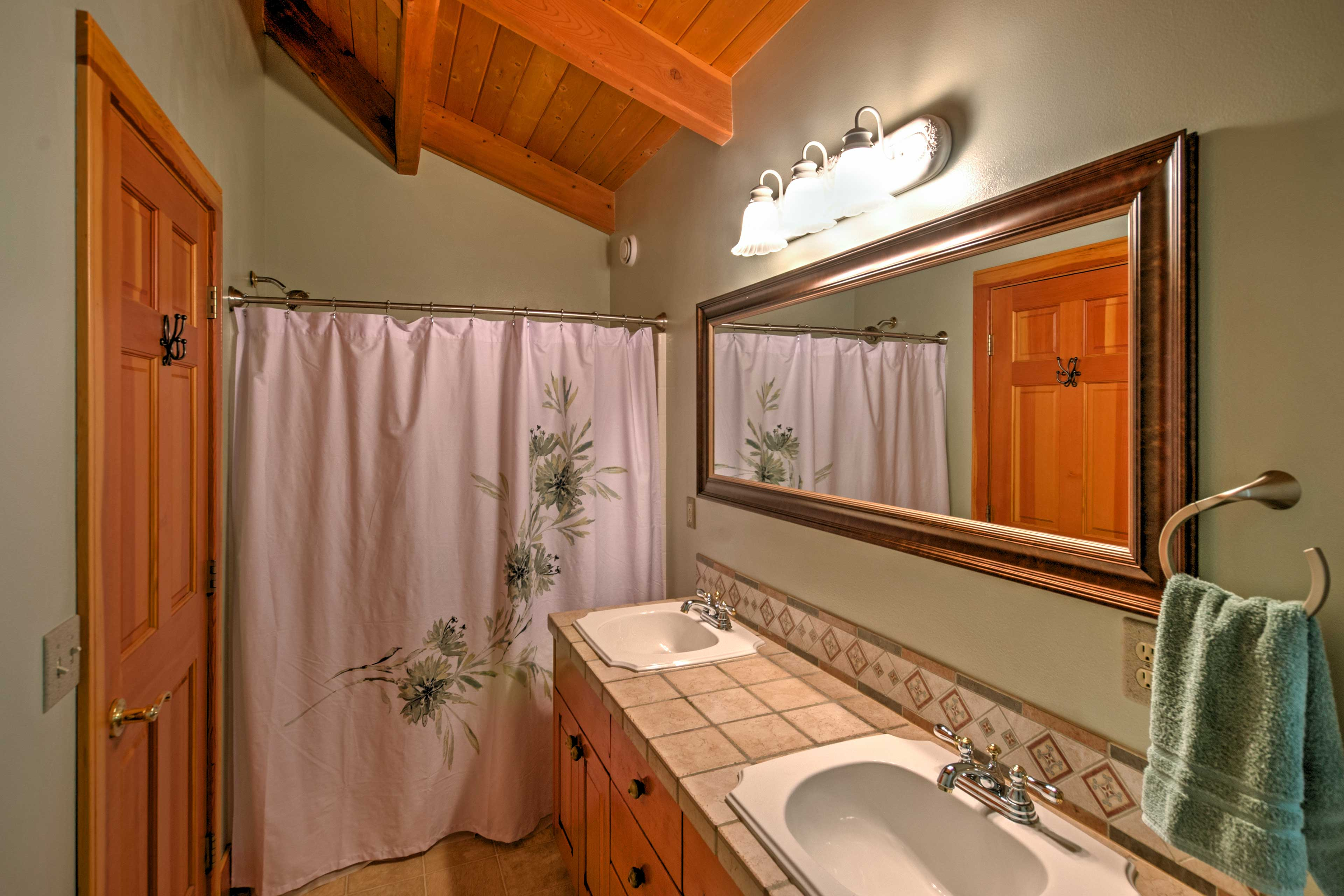 Dual sinks make it easy for multiple people to utilize the bathroom.