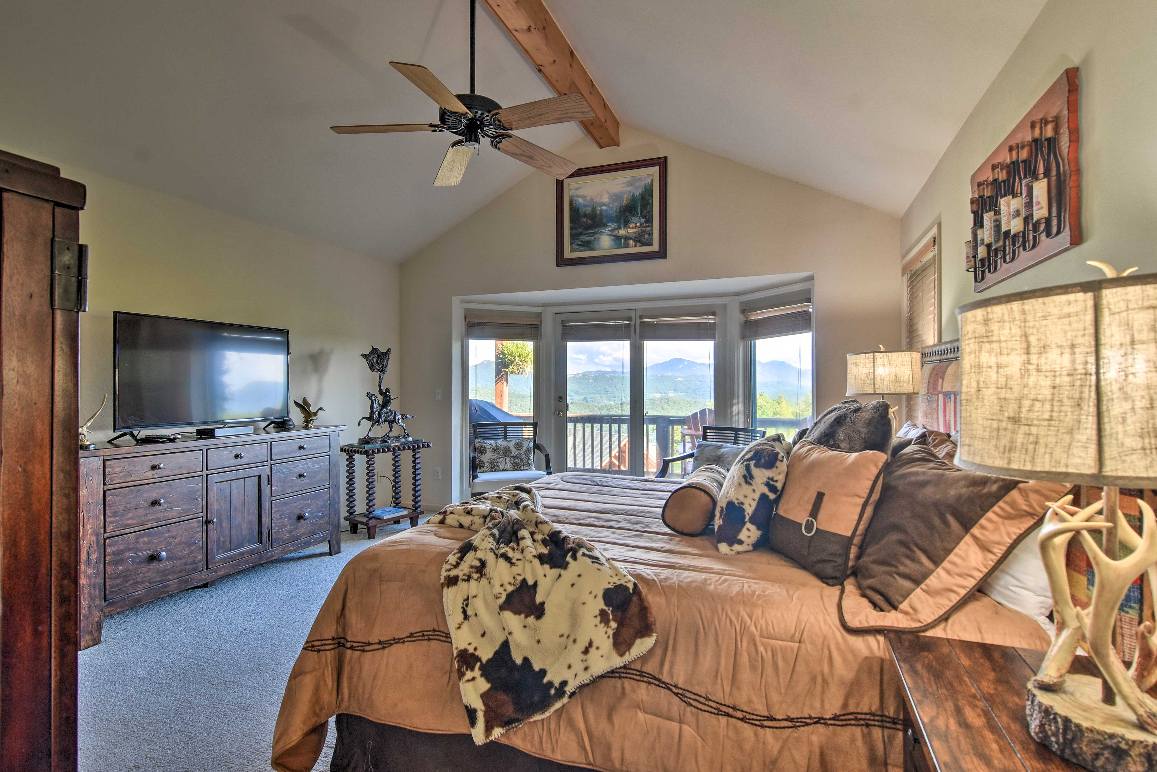 The master bedroom features a king-sized bed and 48-inch flat-screen TV.