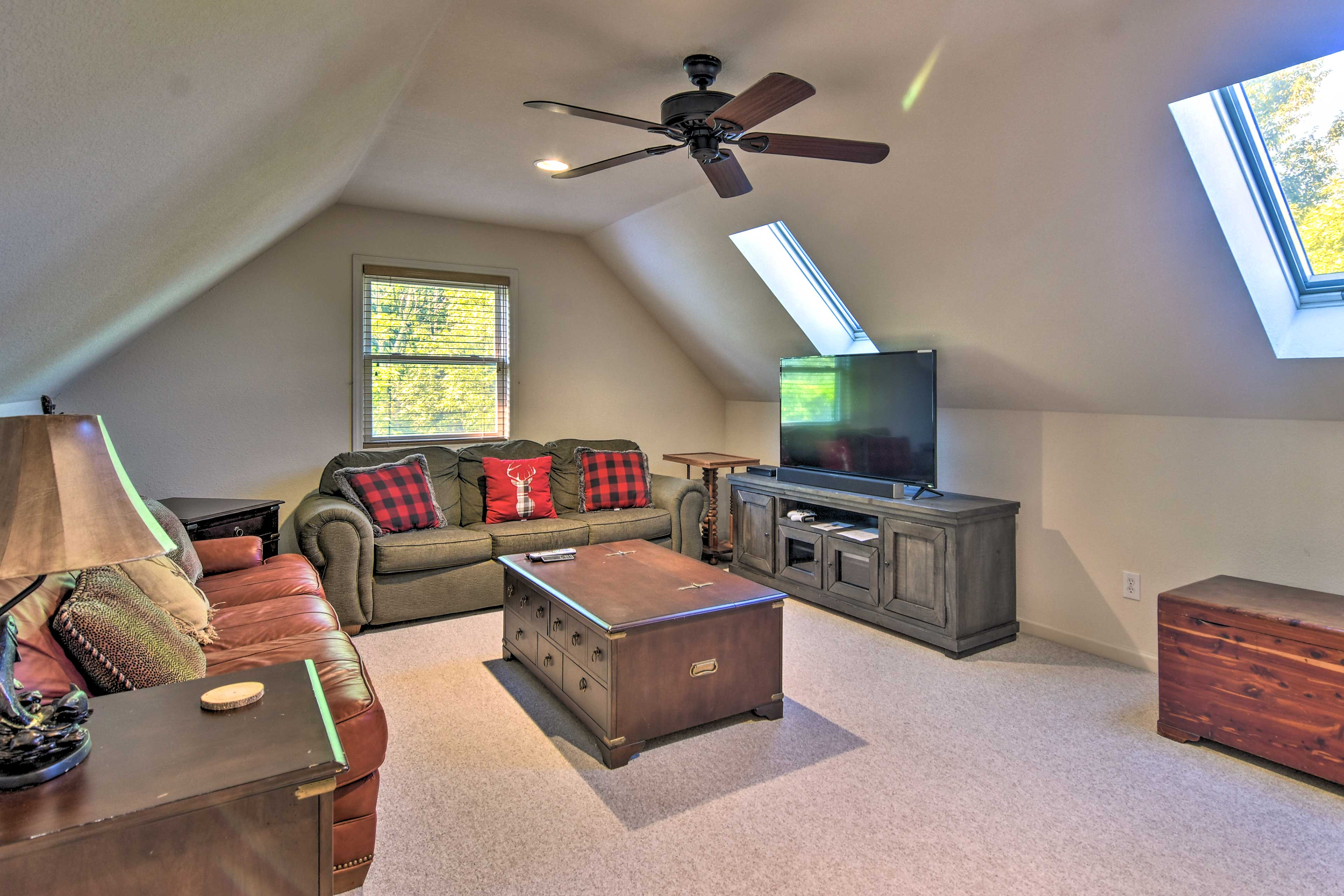 """In the """"Bonus Room"""", play the Xbox One game console on the flat screen Smart TV."""