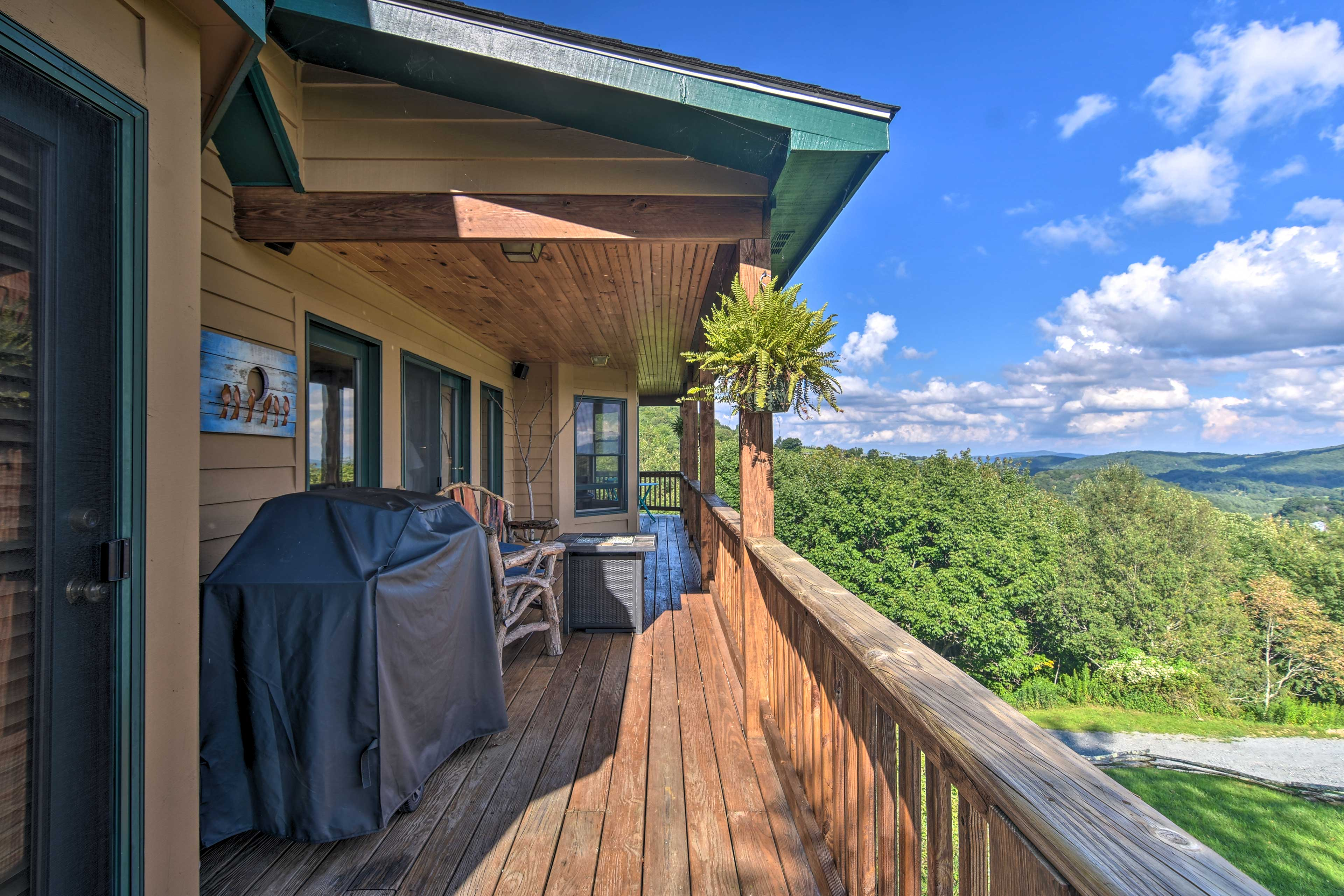 The deck offers stunning views and a stainless steel barbecue grill.